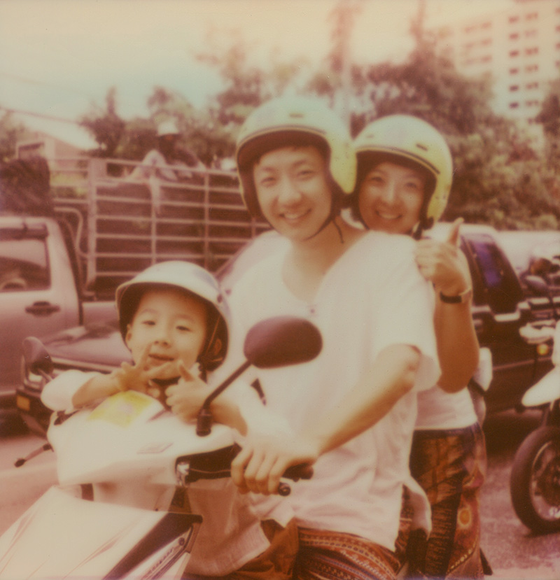 Tourist family on a motorbike in Chiang Mai, Thailand | SLR680 Polaroid