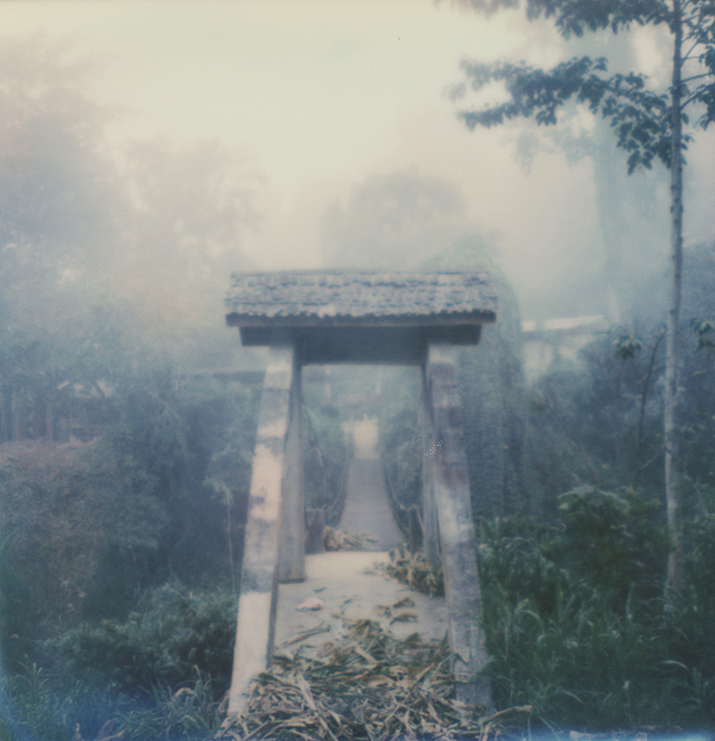 The bridge leading to Chai Lai Orchid, Thailand | SLR680 Polaroid