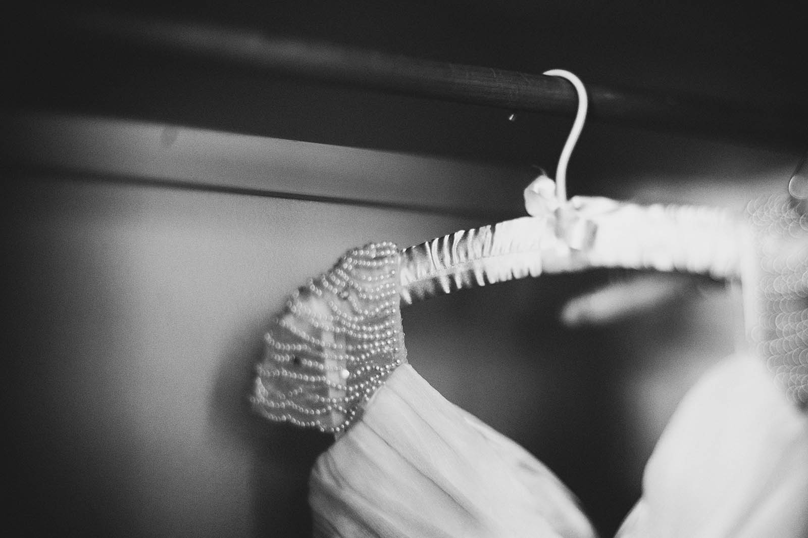 Bride's dress hanging in hotel | Cathedral Park Wedding