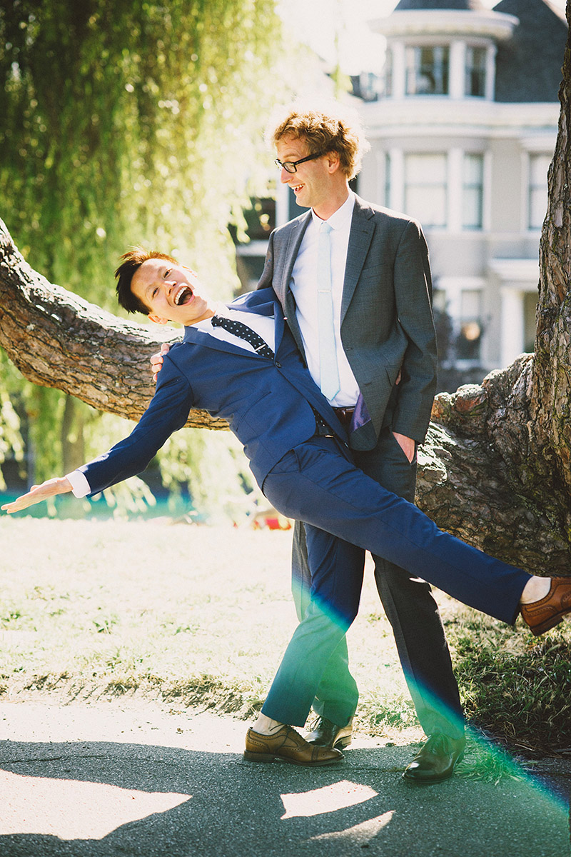 Foreign Cinema Wedding - Grooms goofing off in Alamo Square