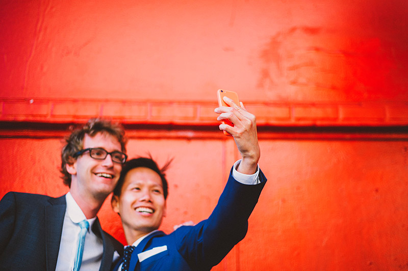 Foreign Cinema Wedding - Grooms taking a selfie before the ceremony