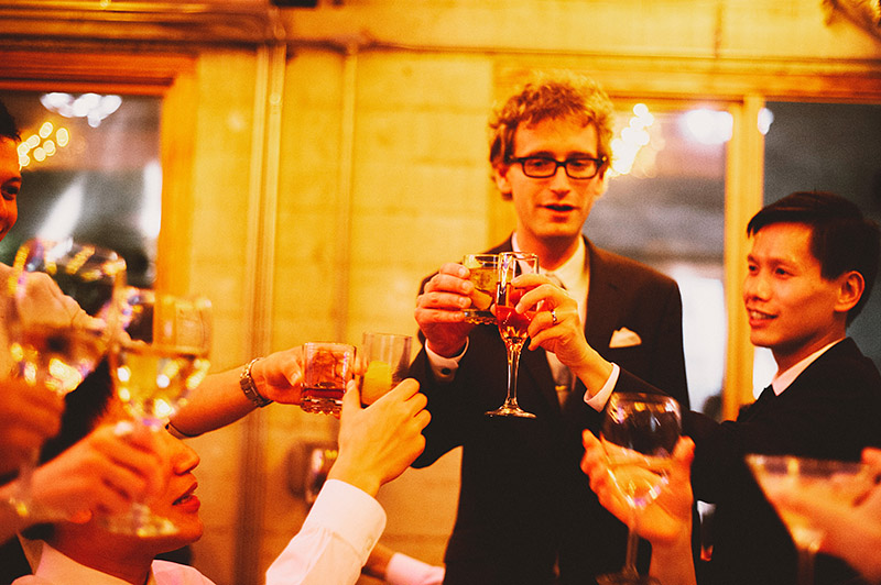 Grooms toasting with guests at a Foreign Cinema wedding