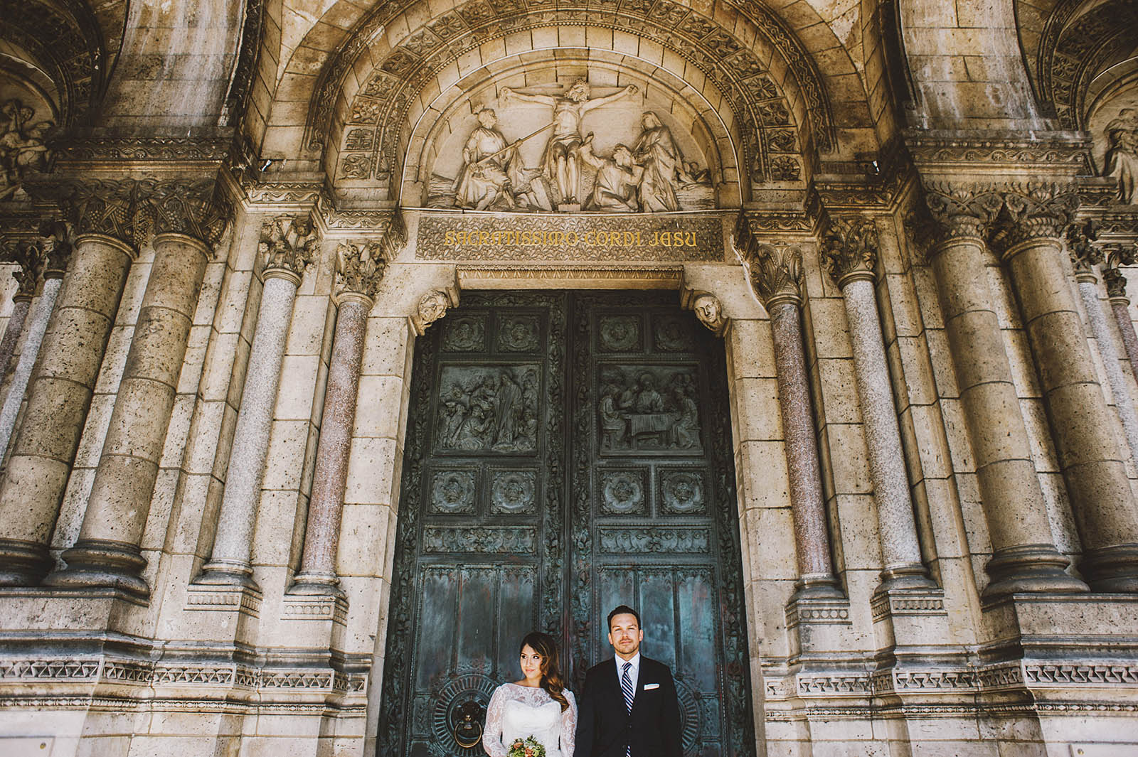 Bride and Groom posing outside Sacre-Coeur | Springtime Paris Elopement at Parc des Buttes Chaumont
