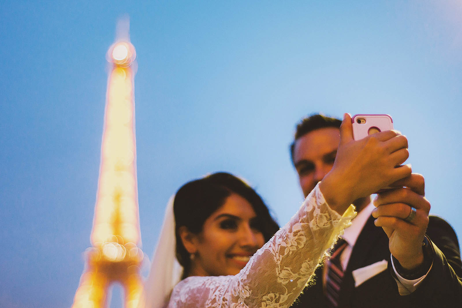 Taking selfies at the Eiffel Tower | Springtime Paris Elopement at Parc des Buttes Chaumont