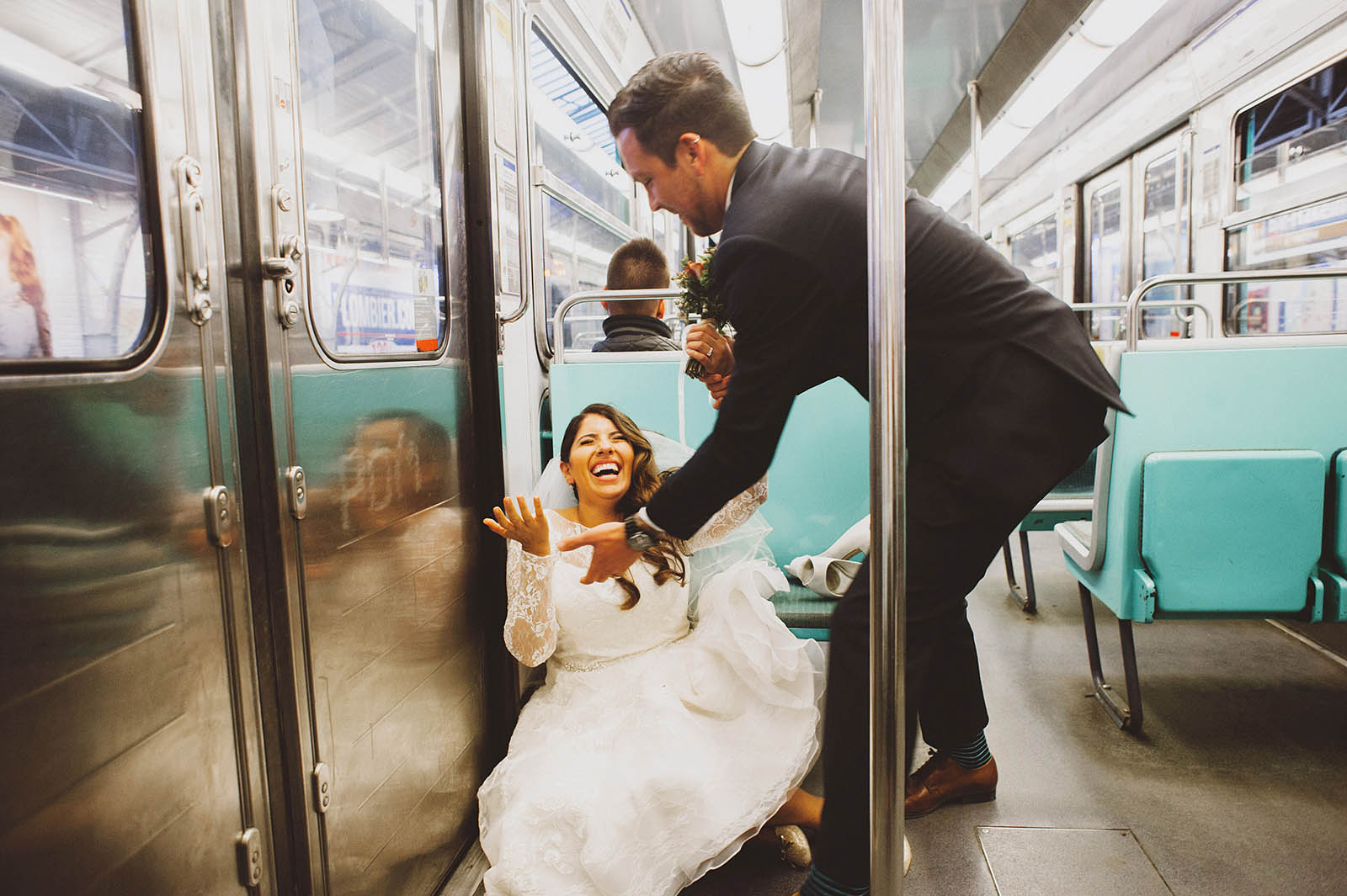 Bride falling down on the Metro | Springtime Paris Elopement at Parc des Buttes Chaumont