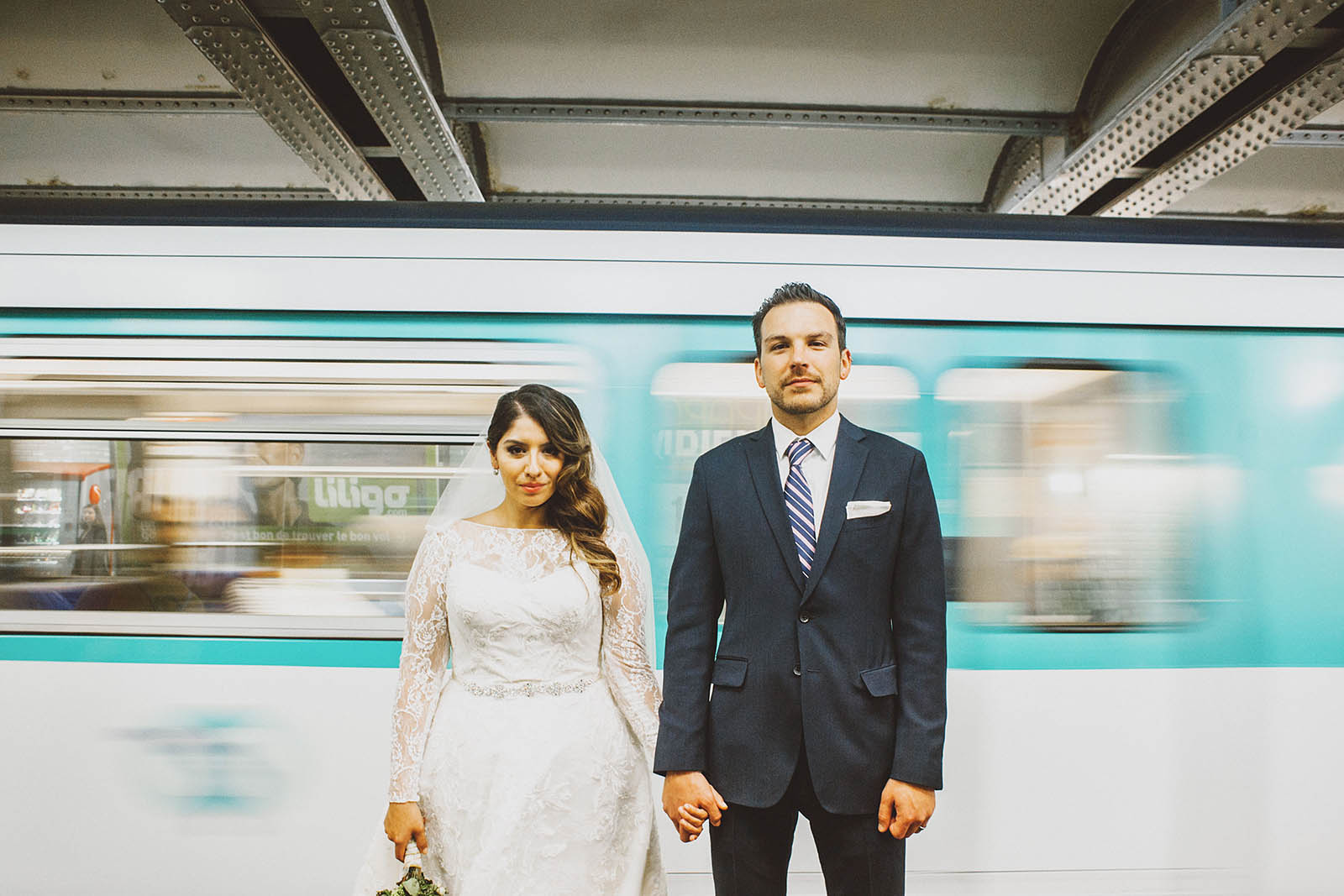 Bride and Groom portrait in front of a Metro train | Springtime Paris Elopement at Parc des Buttes Chaumont