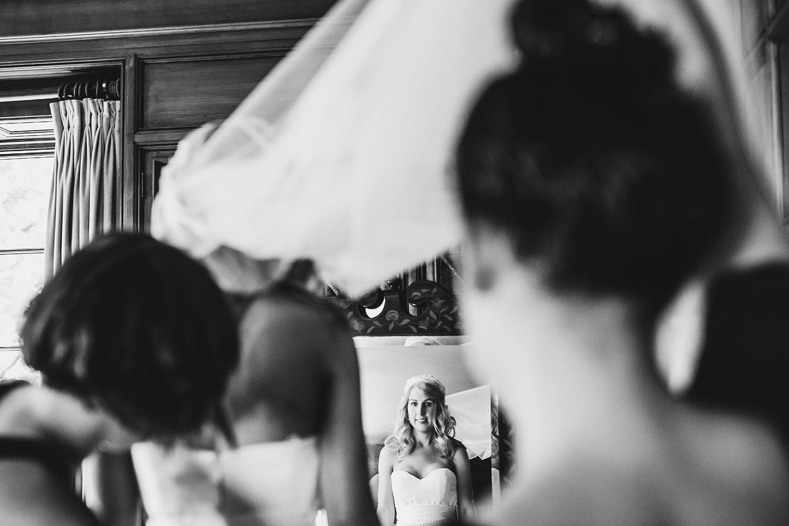 Bridesmaids helping bride get into her dress | Portland Town Club Wedding
