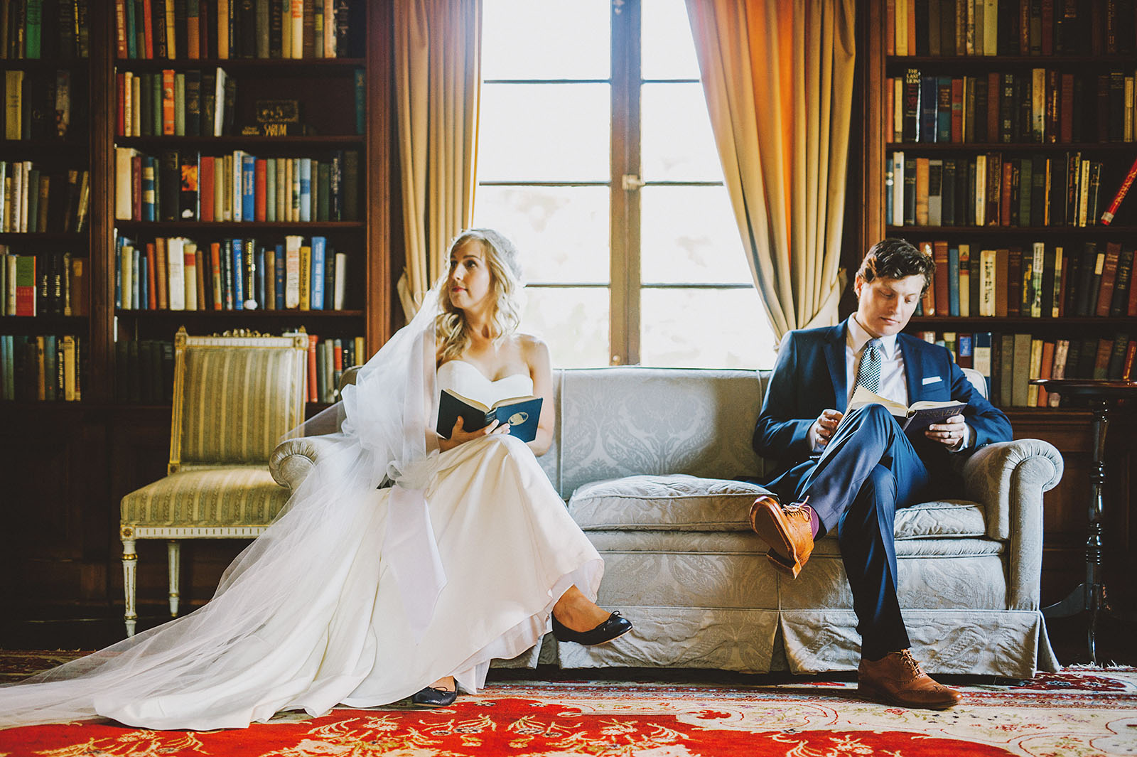 Bride and groom reading books in the library | Portland Town Club Wedding