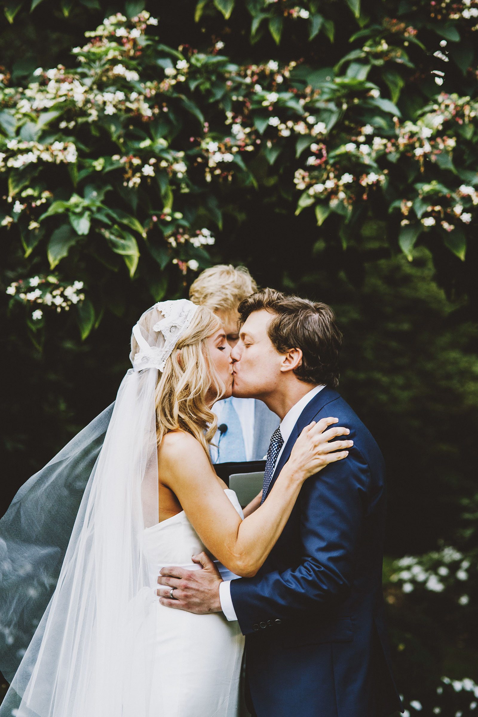 Bride and Groom kissing at the ceremony on the lawn | Portland Town Club Wedding