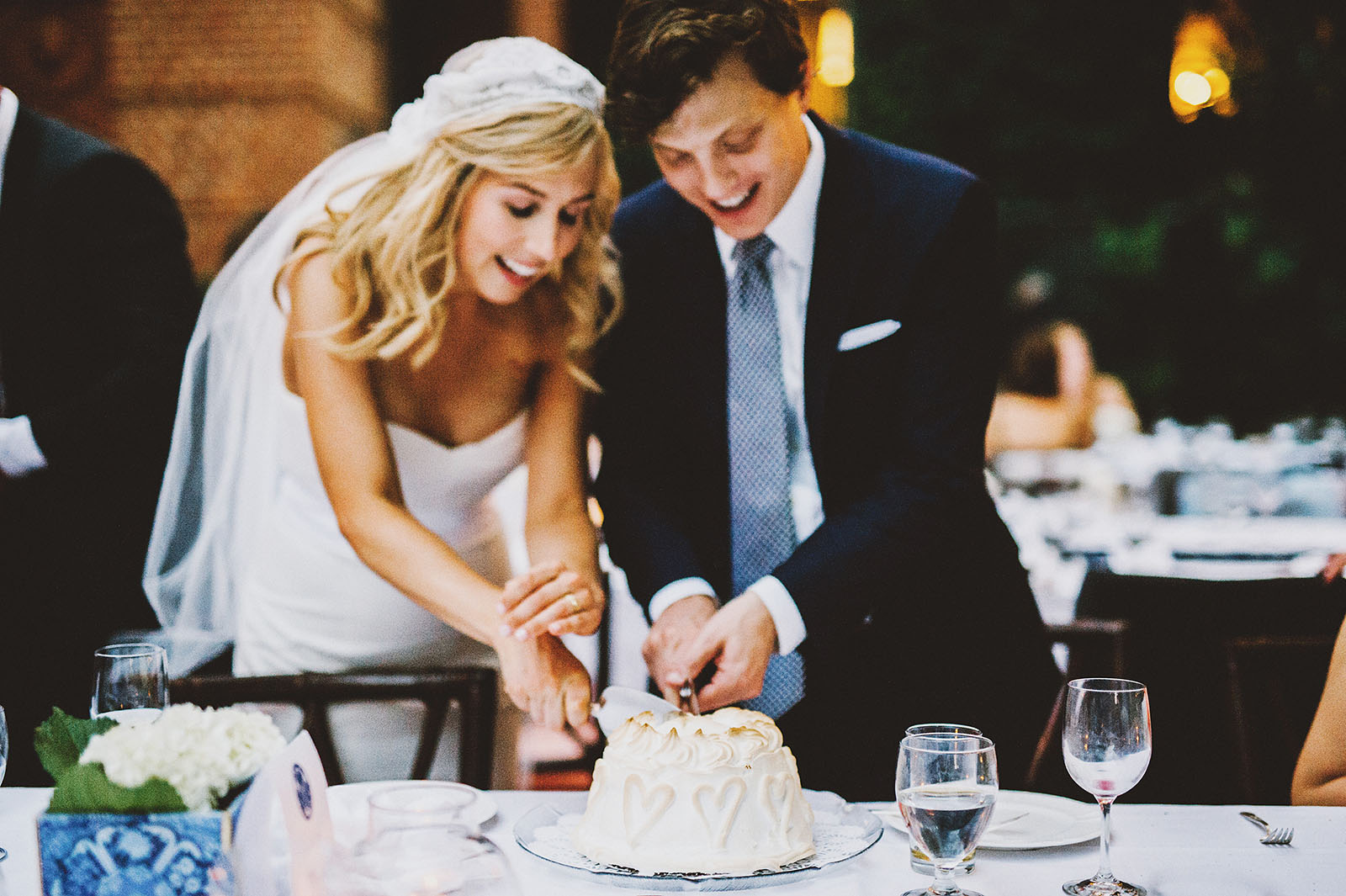 Bride and Groom cutting into their Baked Alaska cake | Portland Town Club Wedding