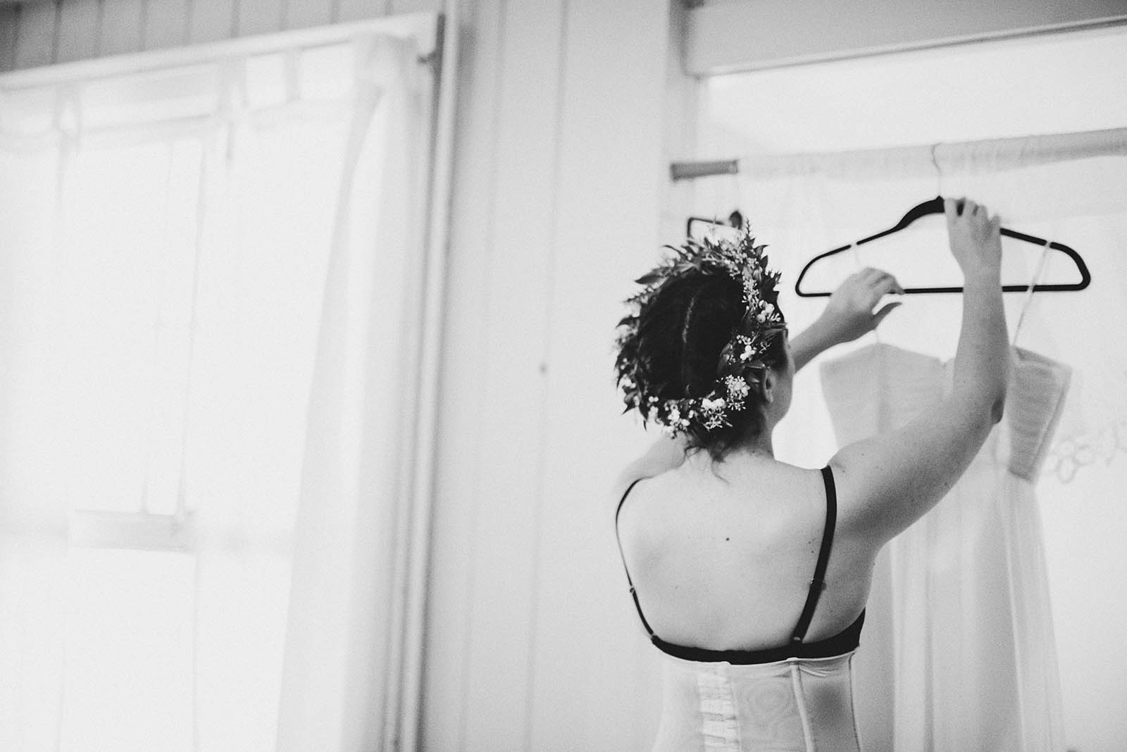Bride getting dressed | SouWester Lodge Wedding