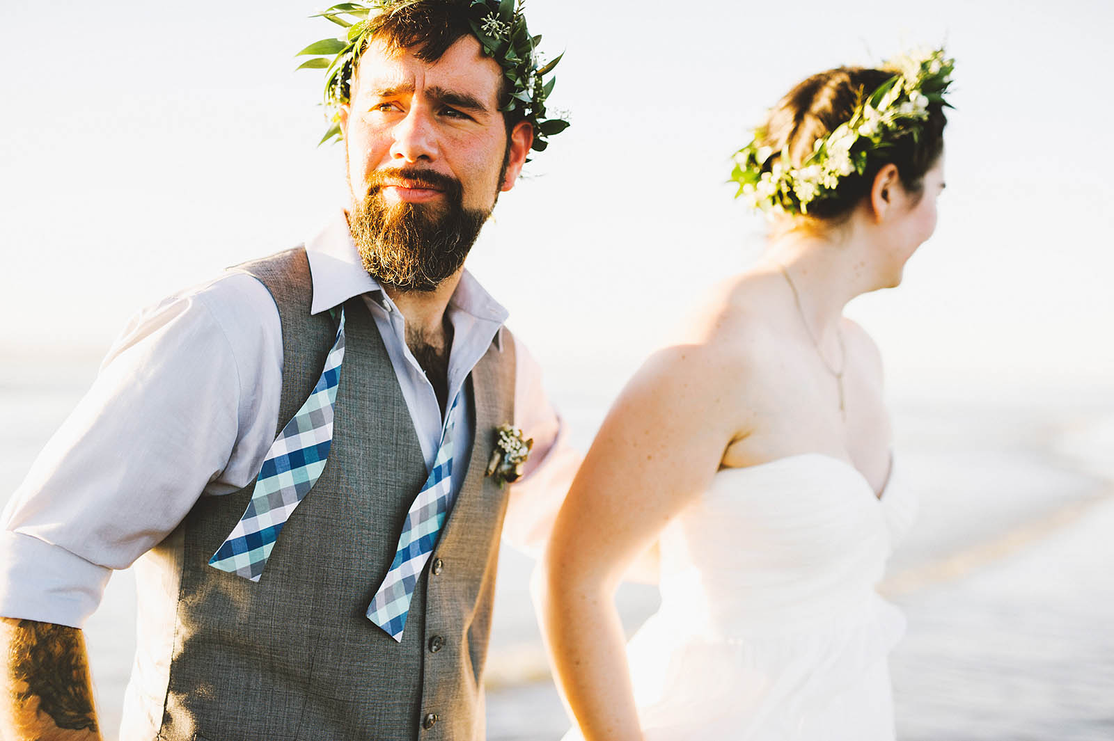 Bride and groom walking on the beach | SouWester Lodge Wedding