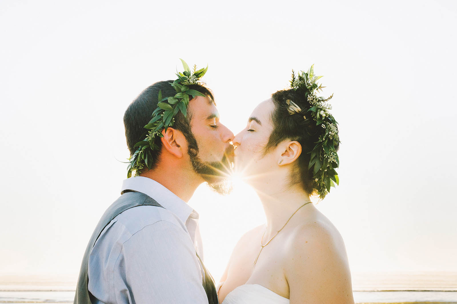 Bride and Groom kissing on the beach | SouWester Lodge Wedding