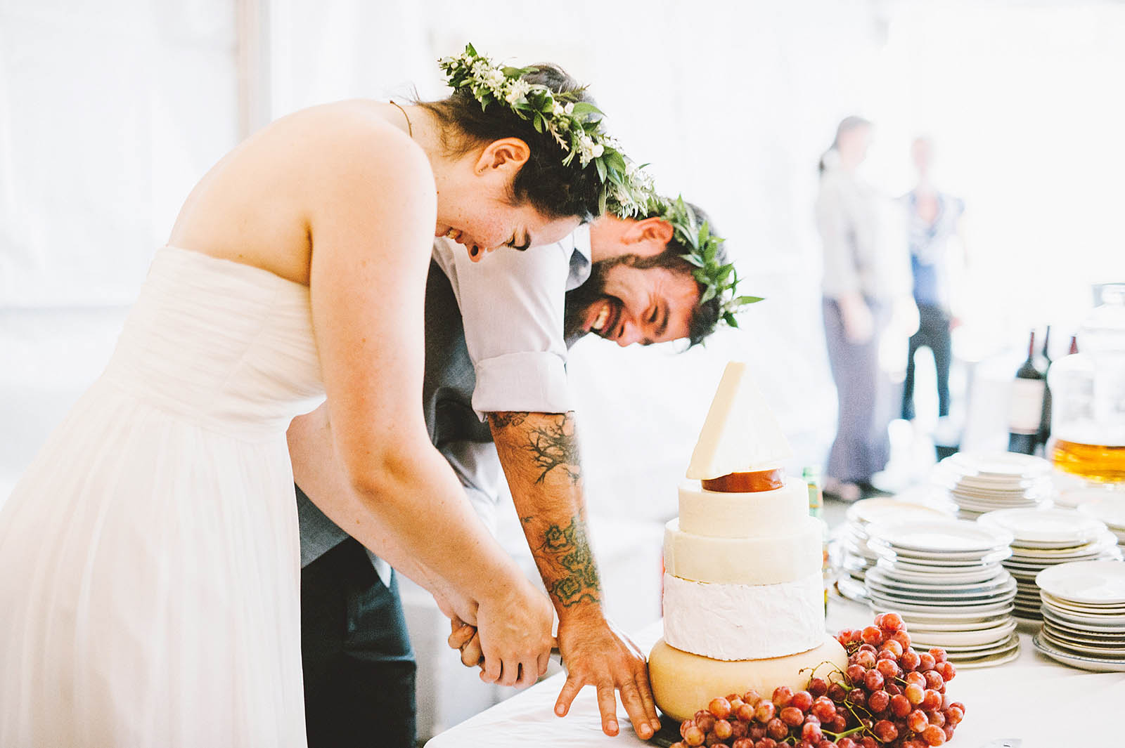 Cutting the cheese cake tower | SouWester Lodge Wedding