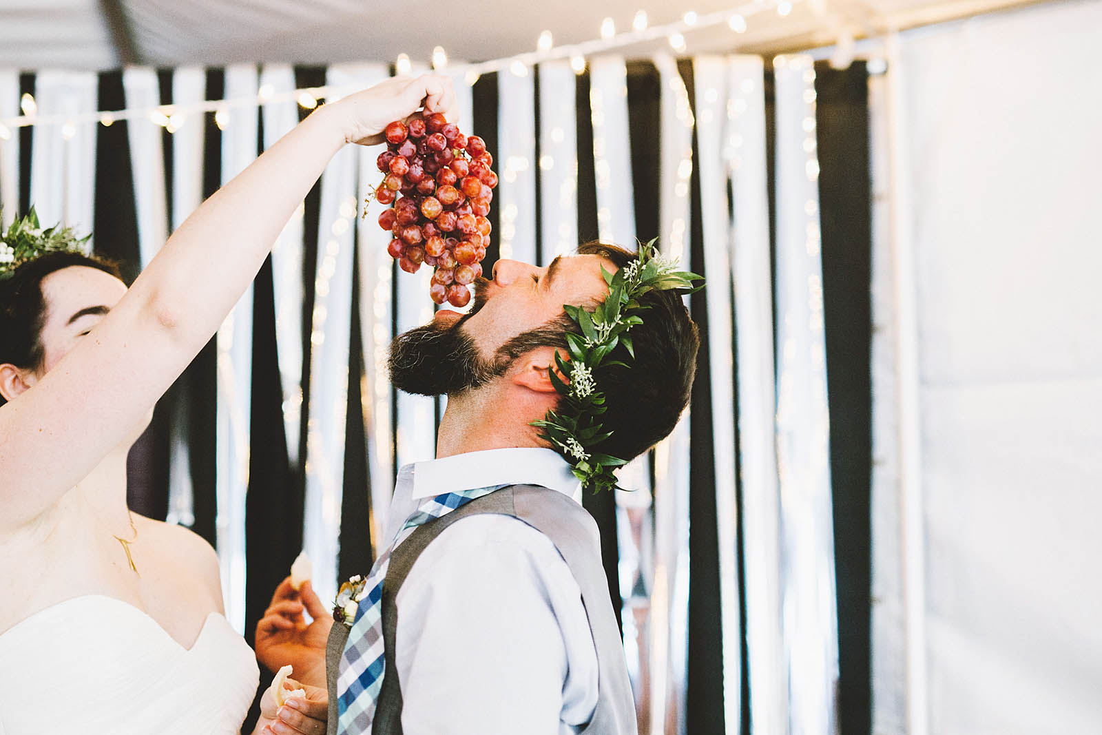 Feeding the groom grapes | SouWester Lodge Wedding