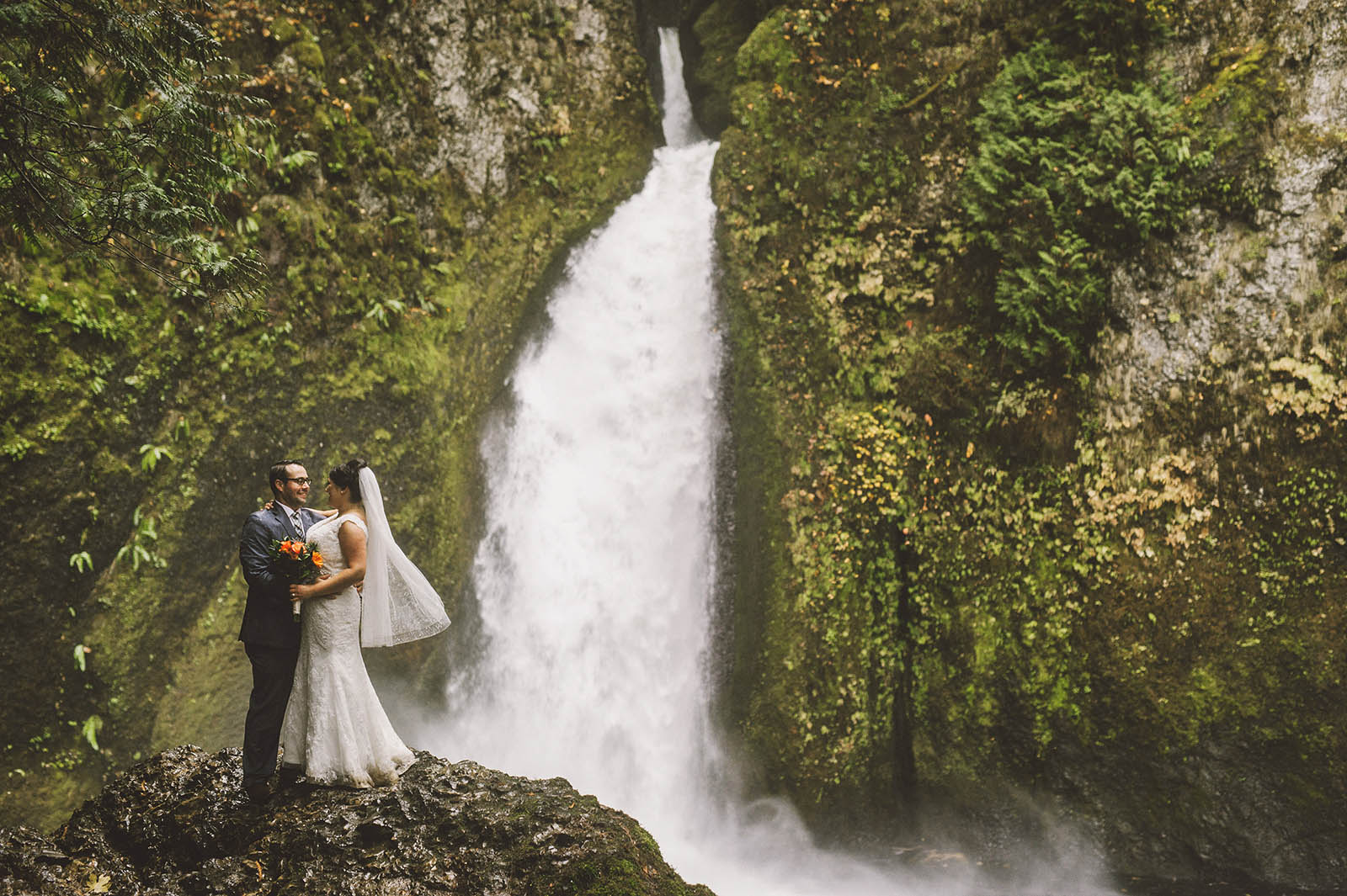 Portrait of Bride and Groom at the waterfall base | Wahclella Falls Elopement
