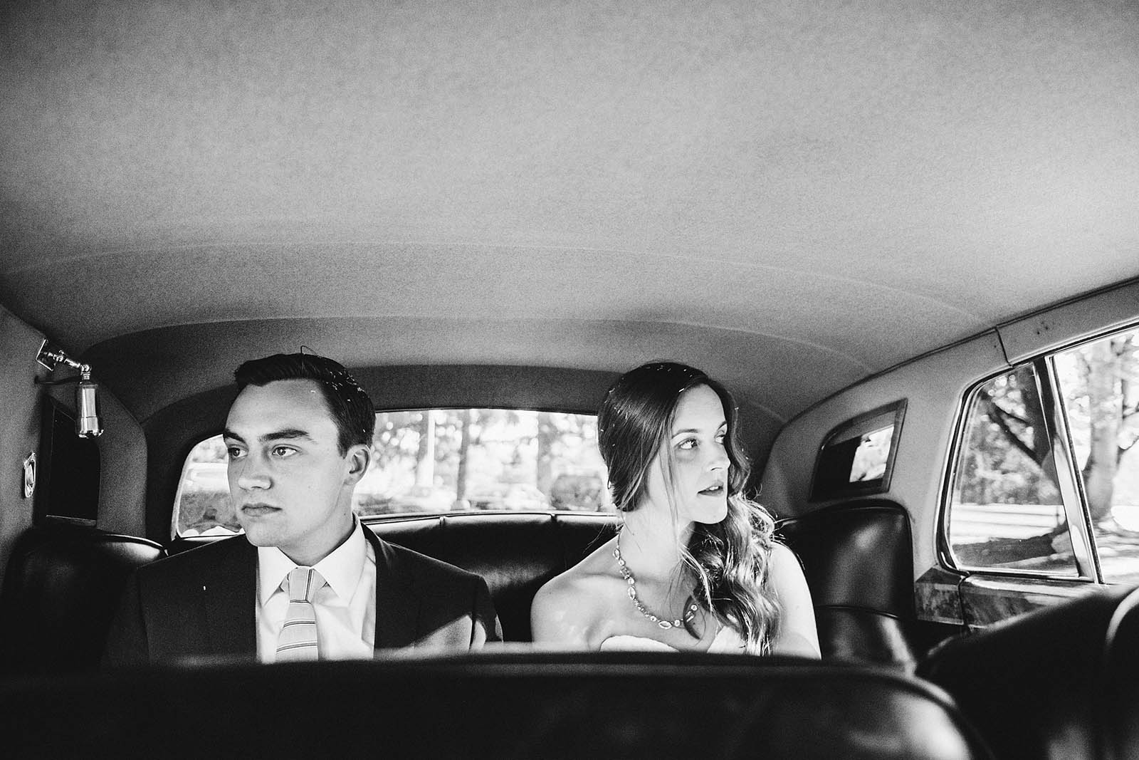 Bride and Groom riding in a car | Fort Vancouver Wedding in Washington