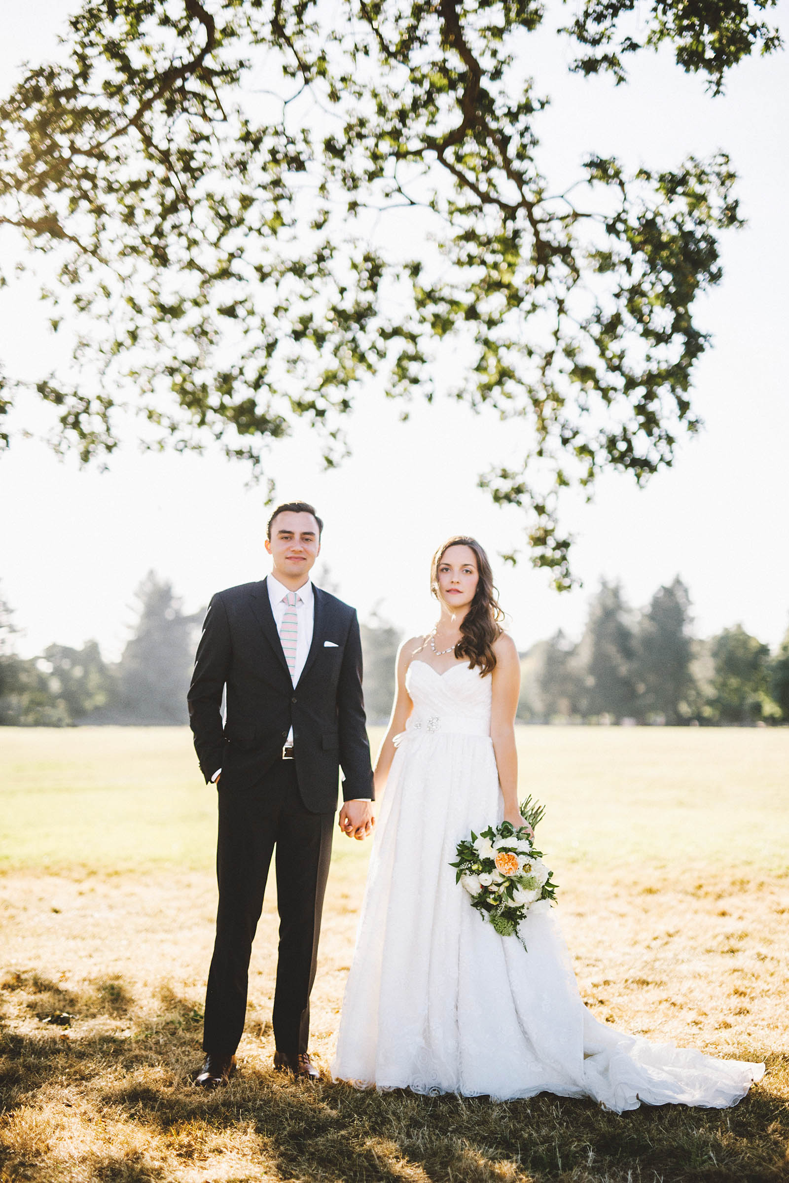 Bride and Groom standing under a tree | Fort Vancouver Wedding in Washington