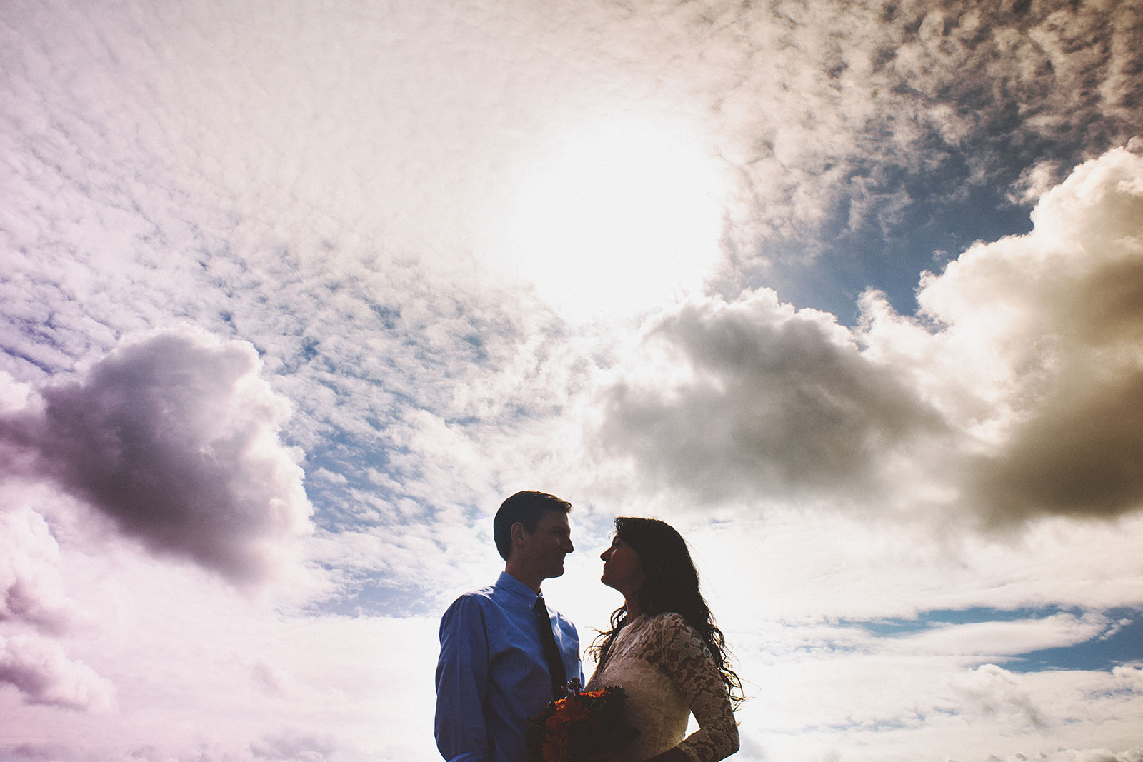 Silhouette of Bride and Groom with clouds | Portland Courthouse Wedding