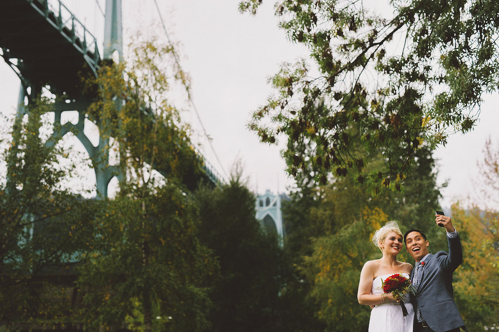 Newlyweds taking a selfie under the St. John's Bridge | Portland Oregon Elopement