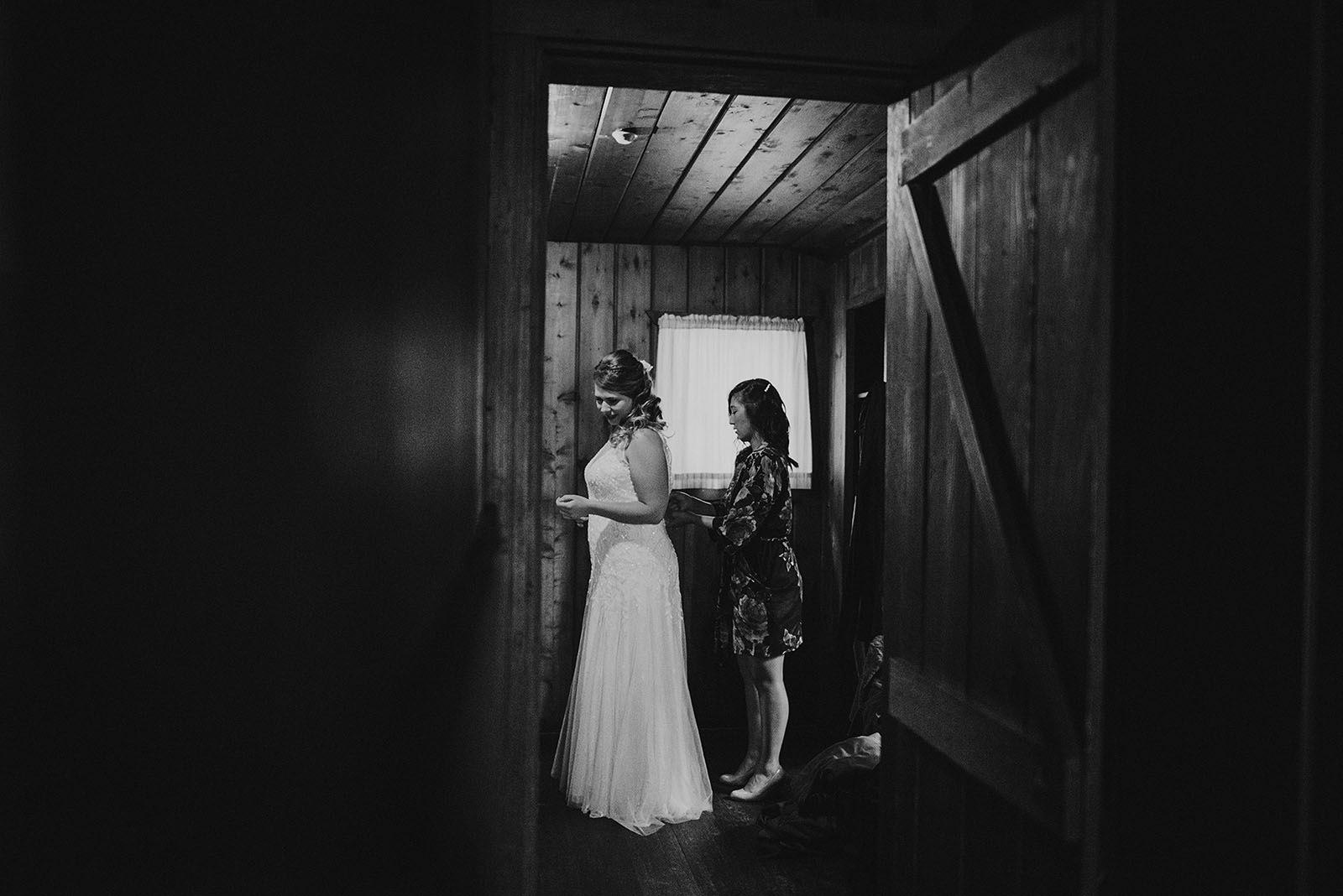 Bride putting on her gown | Camano Island Wedding
