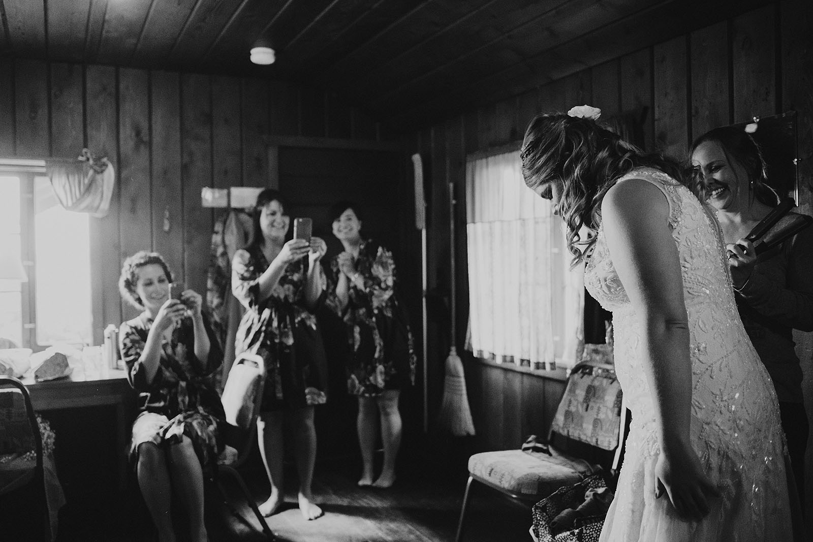 Bride revealing the dress to her bridesmaids | Camano Island Wedding