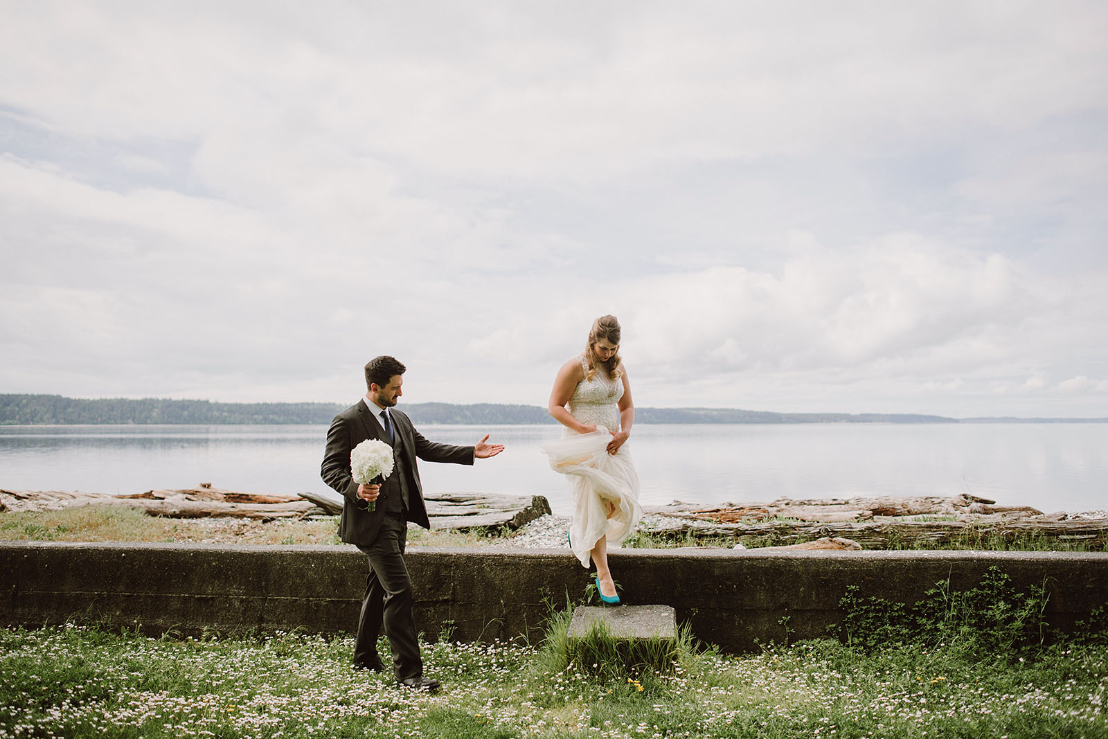 Groom helping bride down the steps | Camano Island Wedding
