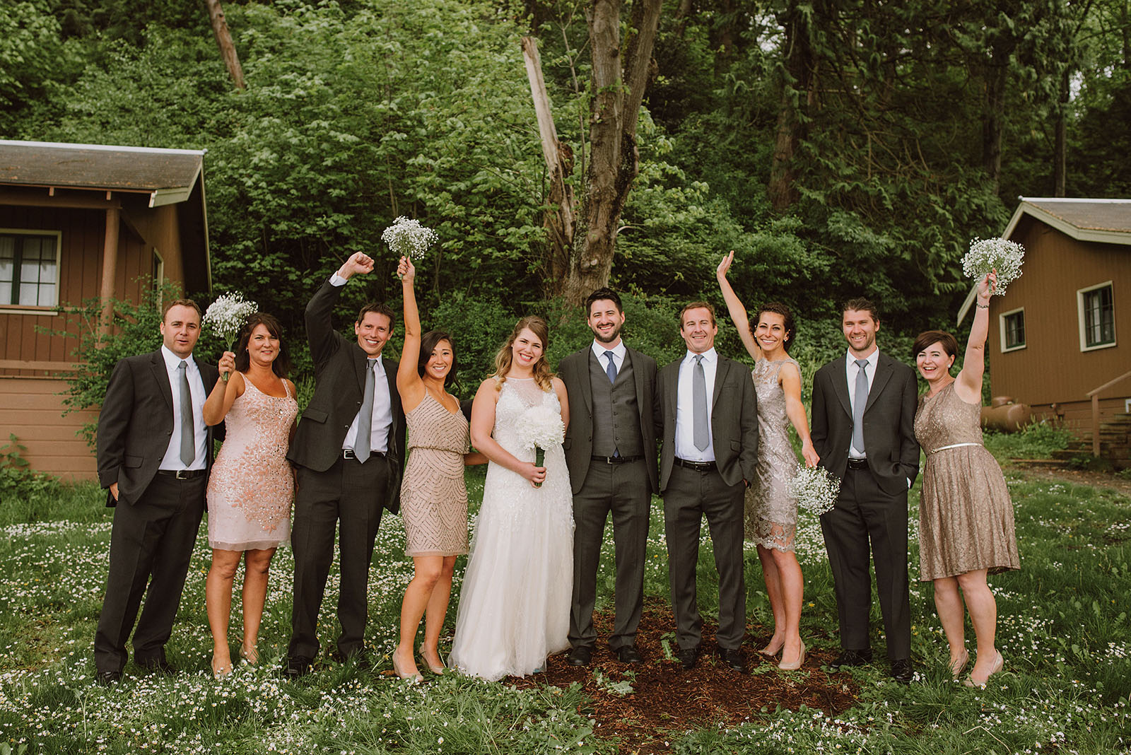 Wedding party cheering at Cama Beach State Park | Camano Island Wedding