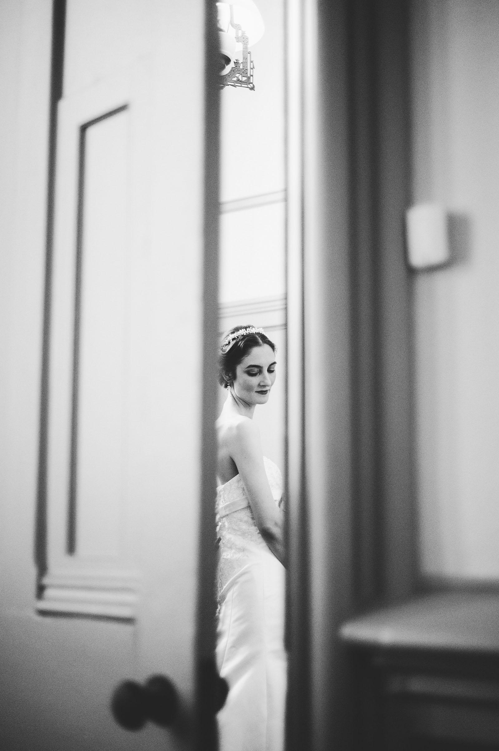 Portrait of bride dressing through doorway | Old Church Wedding Photos