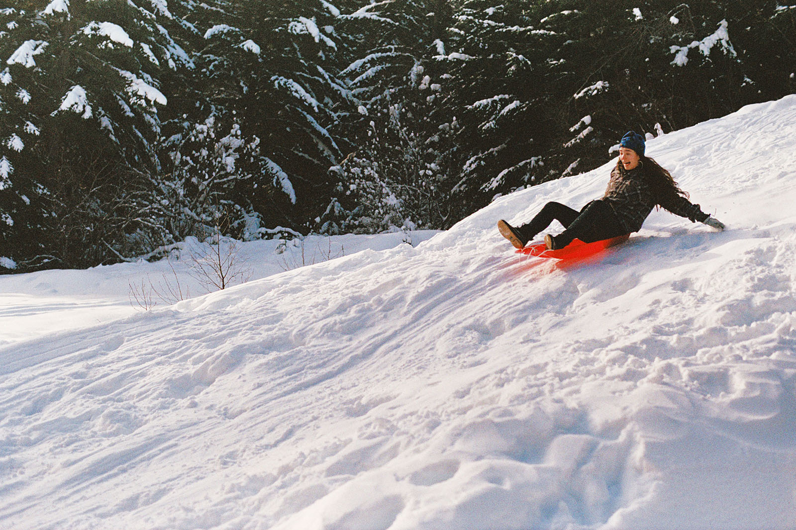 Richelle sledding down the snow in Trout Lake, WA | Contax Aria