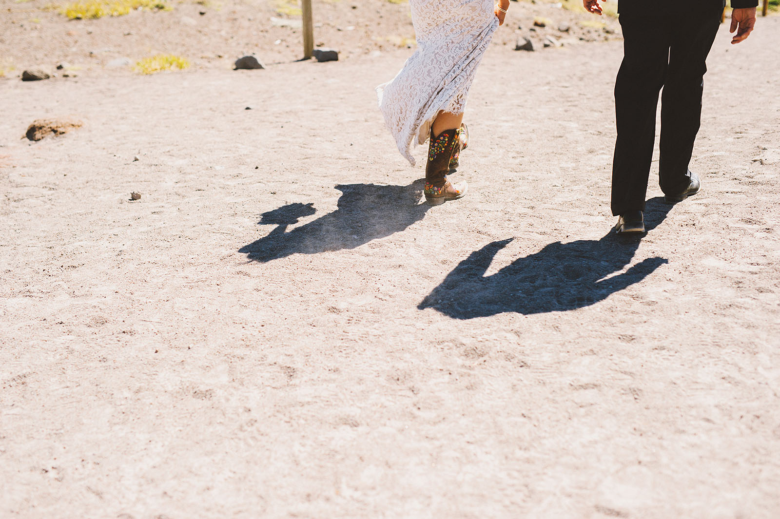 Bride wearing cowboy boots | Mazama Lodge Wedding