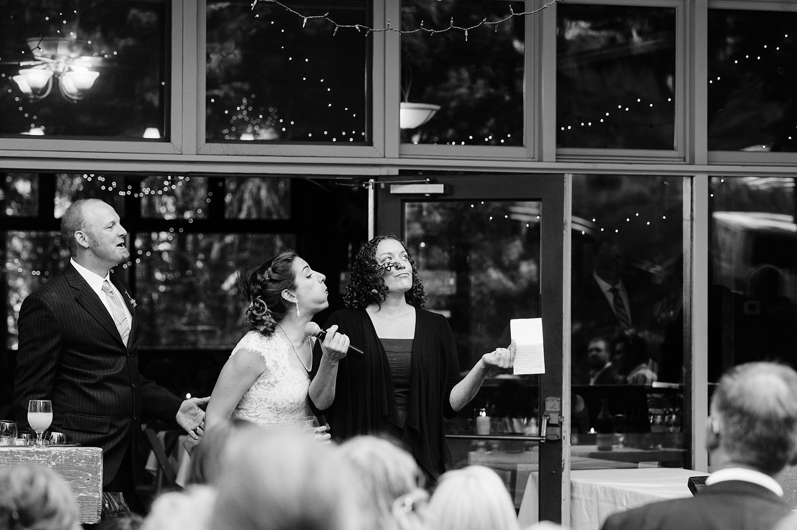 Bride blowing into Maid of Honor's teary eyes | Mazama Lodge Wedding