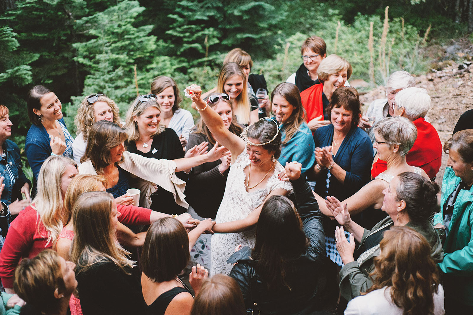 Bride huddling with all of her ladies | Mazama Lodge Wedding