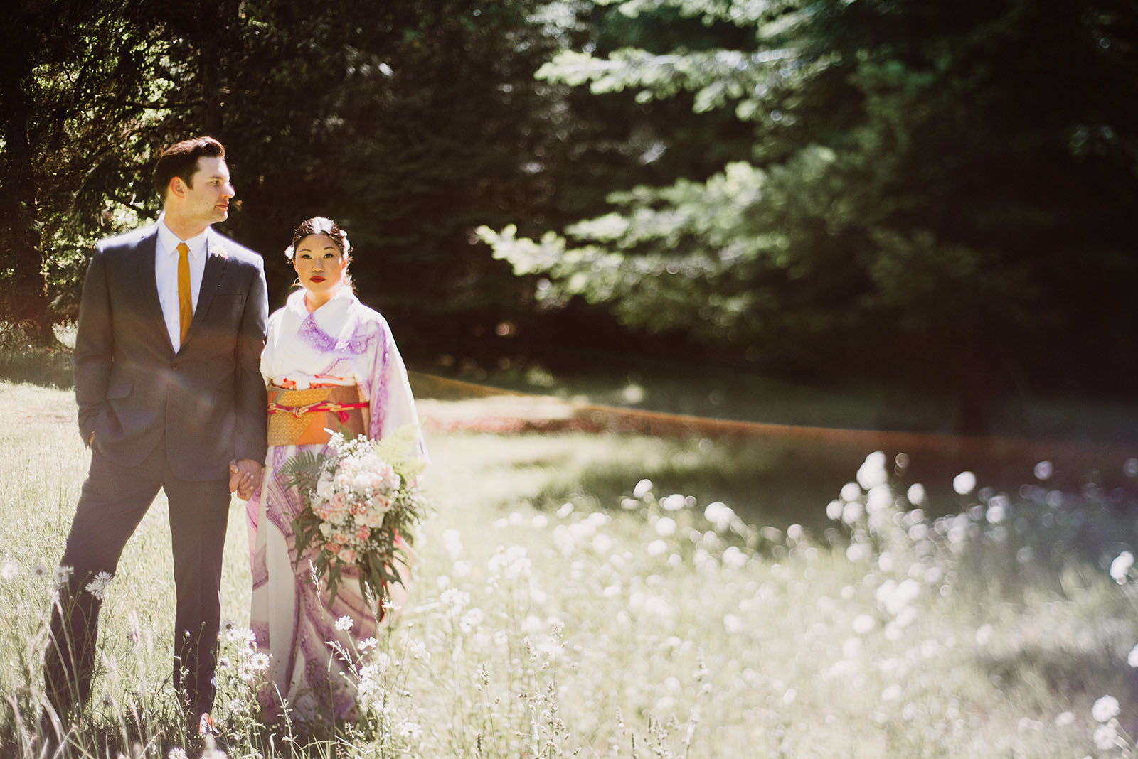 Lens flare portrait of bride and groom | Olympic National Park Wedding