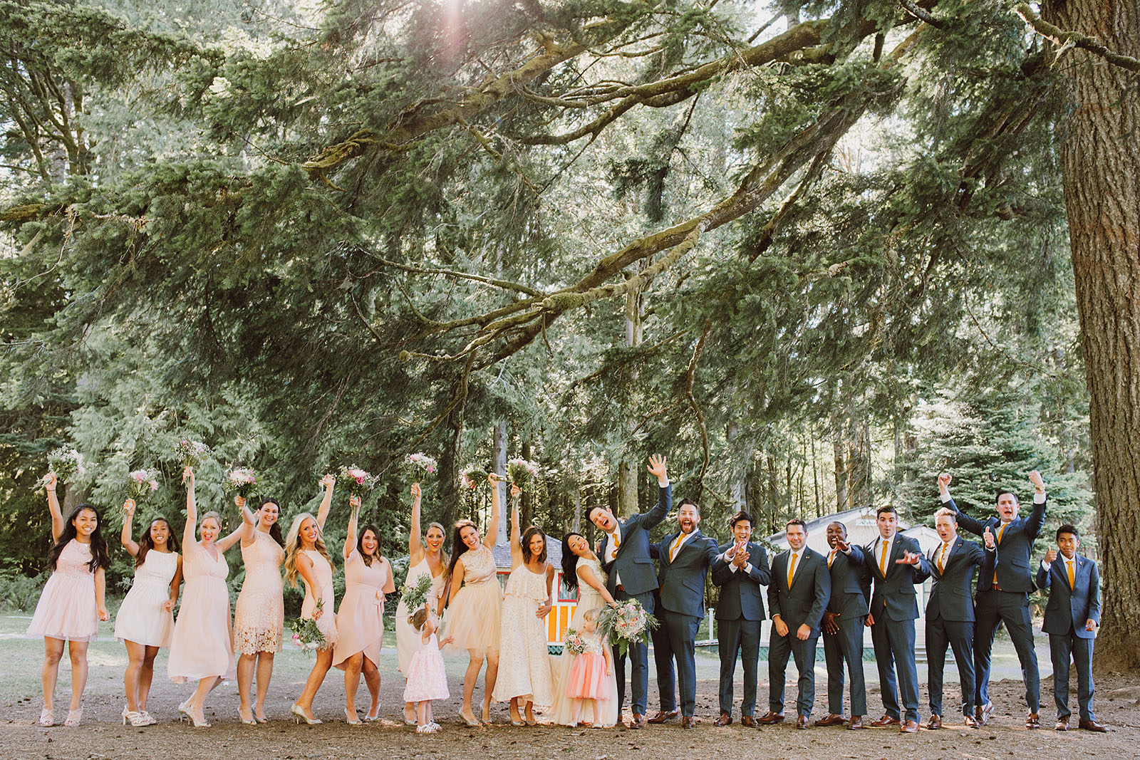 Group photo of the wedding party cheering | Olympic National Park Wedding