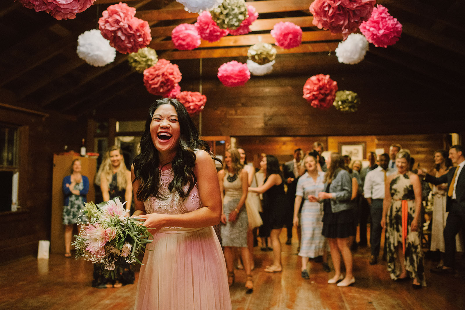Bride laughing during the bouquet toss | Olympic National Park Wedding