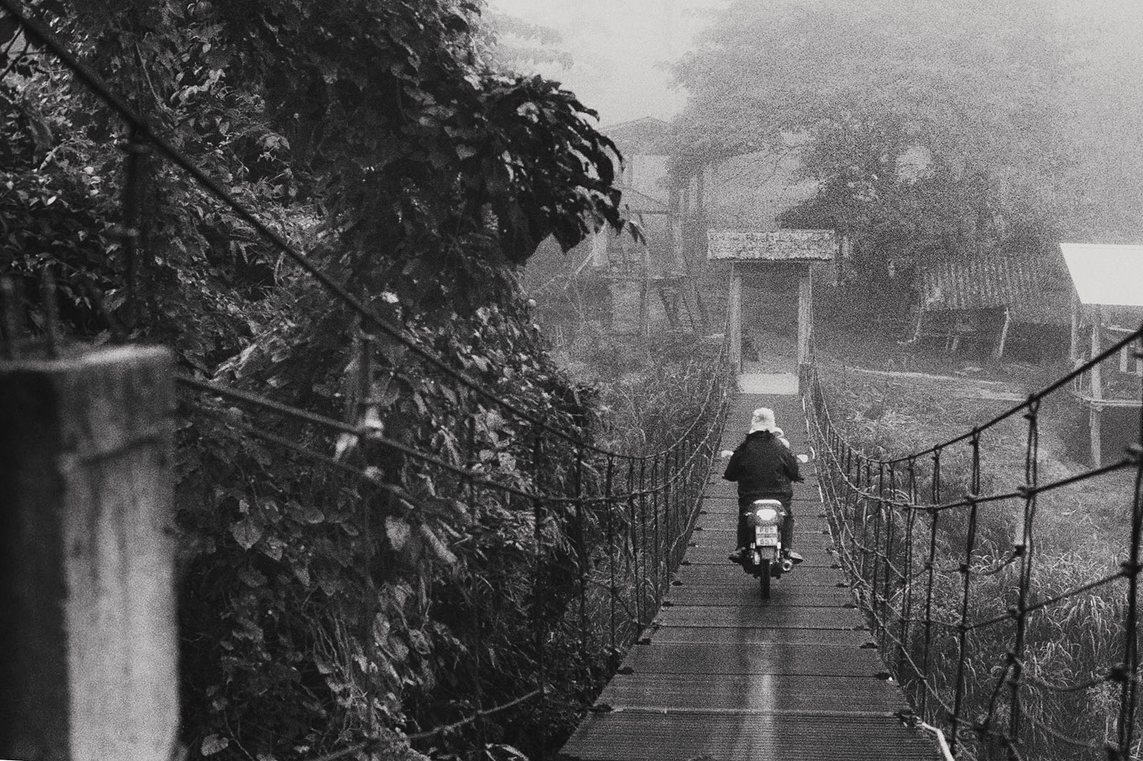 Motorbike driving over the bridge to Chai Lai Orchid | Thailand Travel Photos