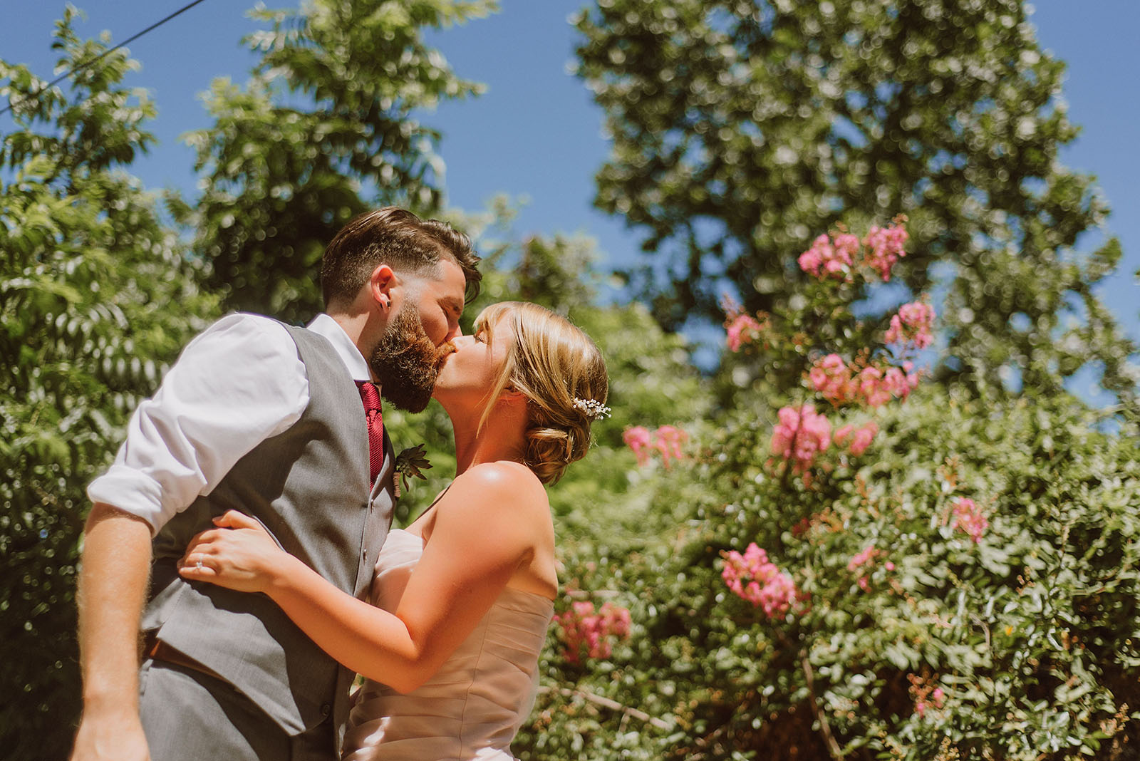 Bride and Groom kissing | Backyard Chico California Wedding