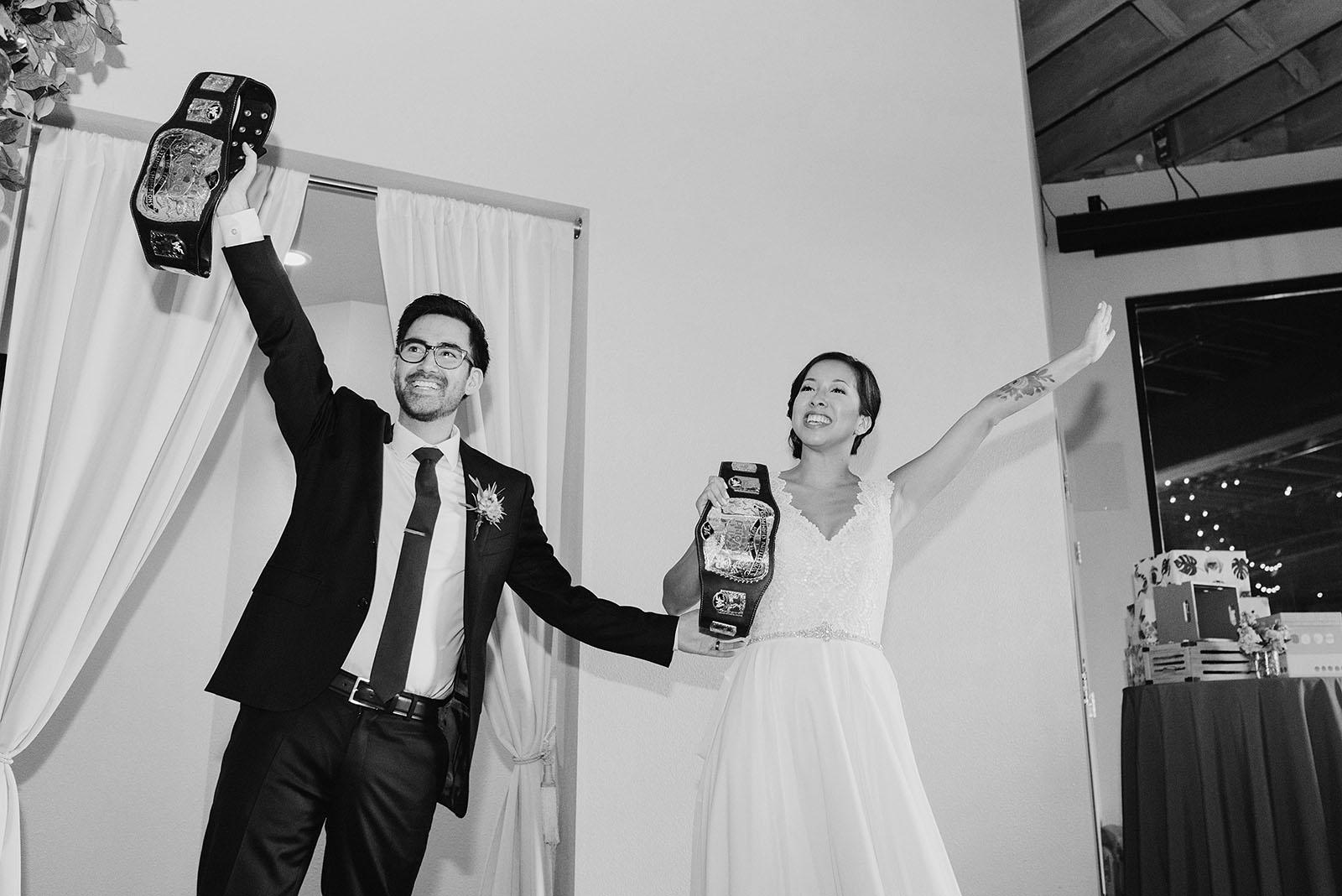Bride and Groom's grand entrance with wrestling belts | Portland Castaway Wedding