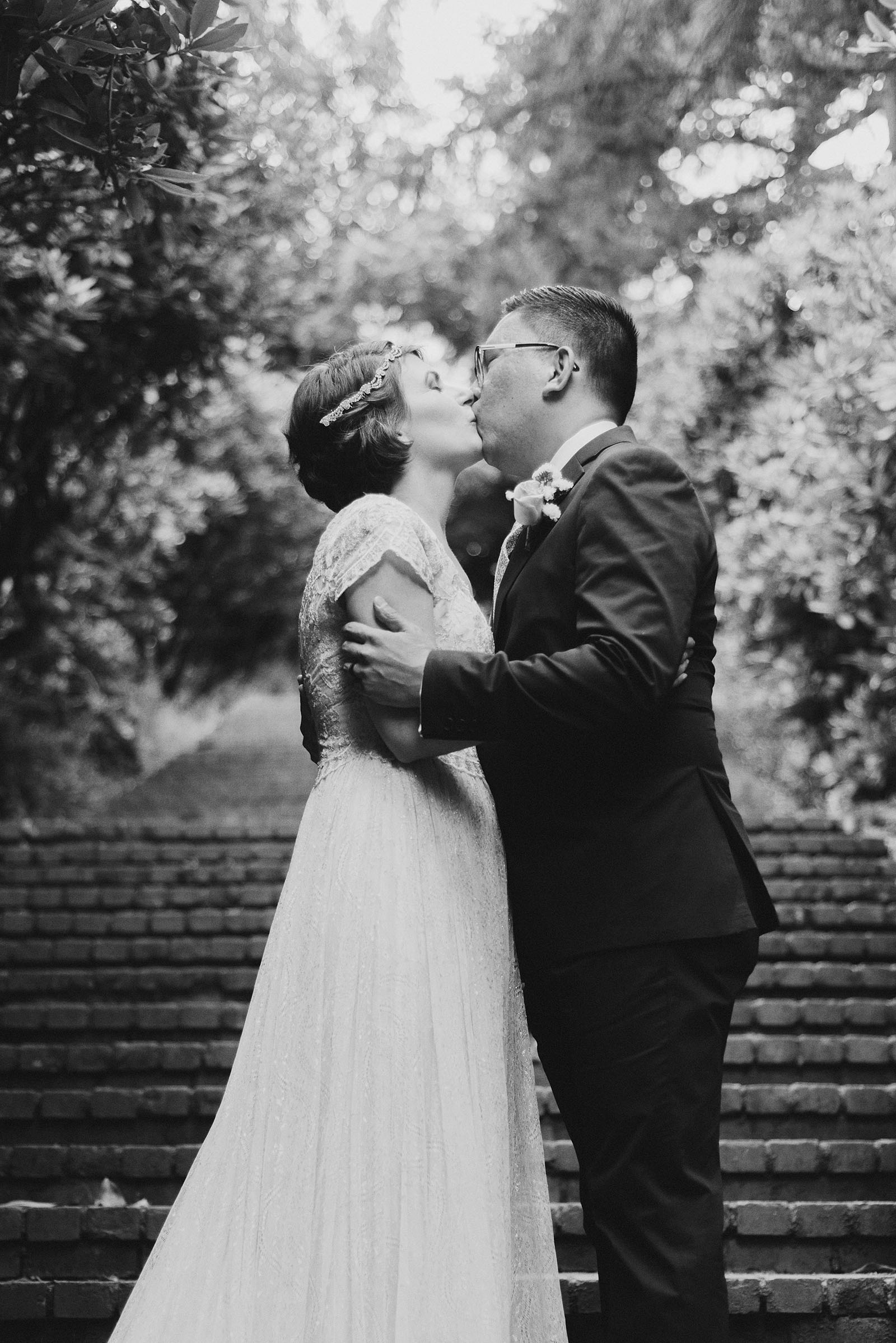 Bride and Groom's first kiss in Laurelhurst Park | Downtown Portland Elopement