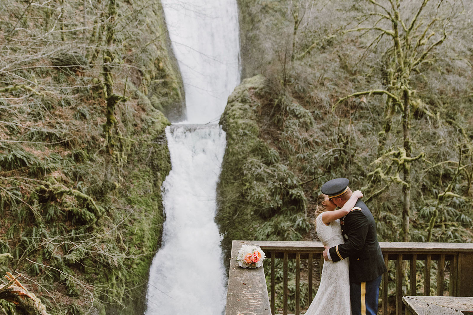 Bride and Groom hugging in front of a waterfall | Bridal Veil Elopement Photographer