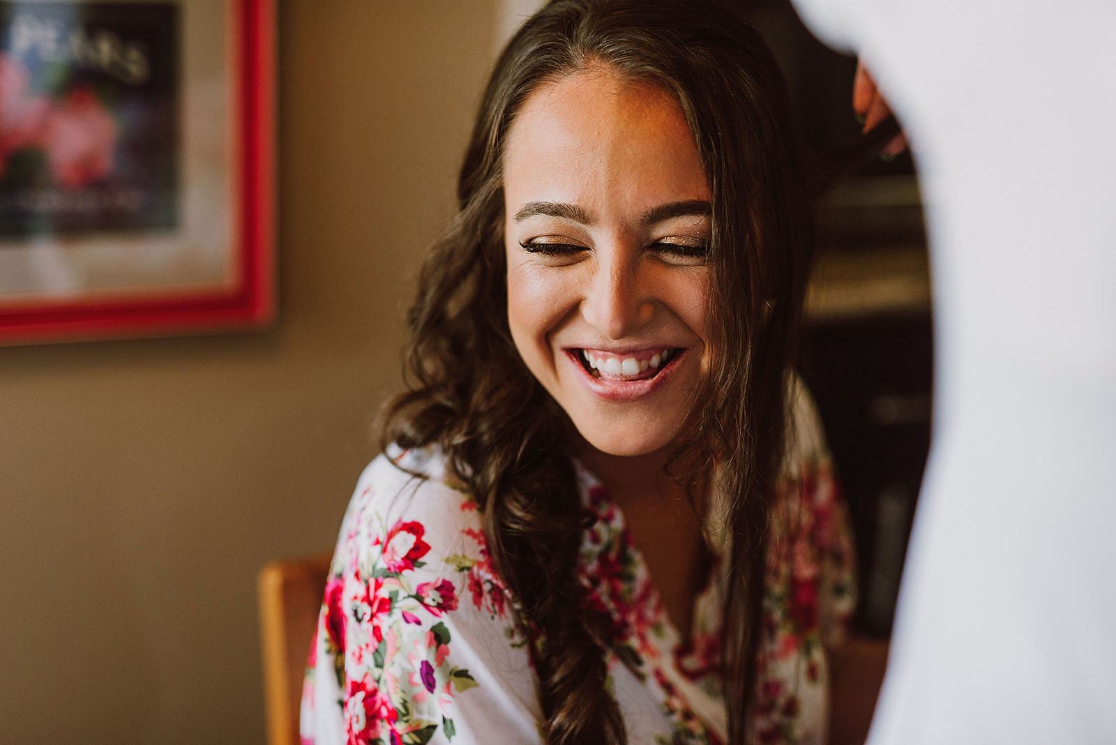 bride laughing while having her makeup done - Portland Wedding photography