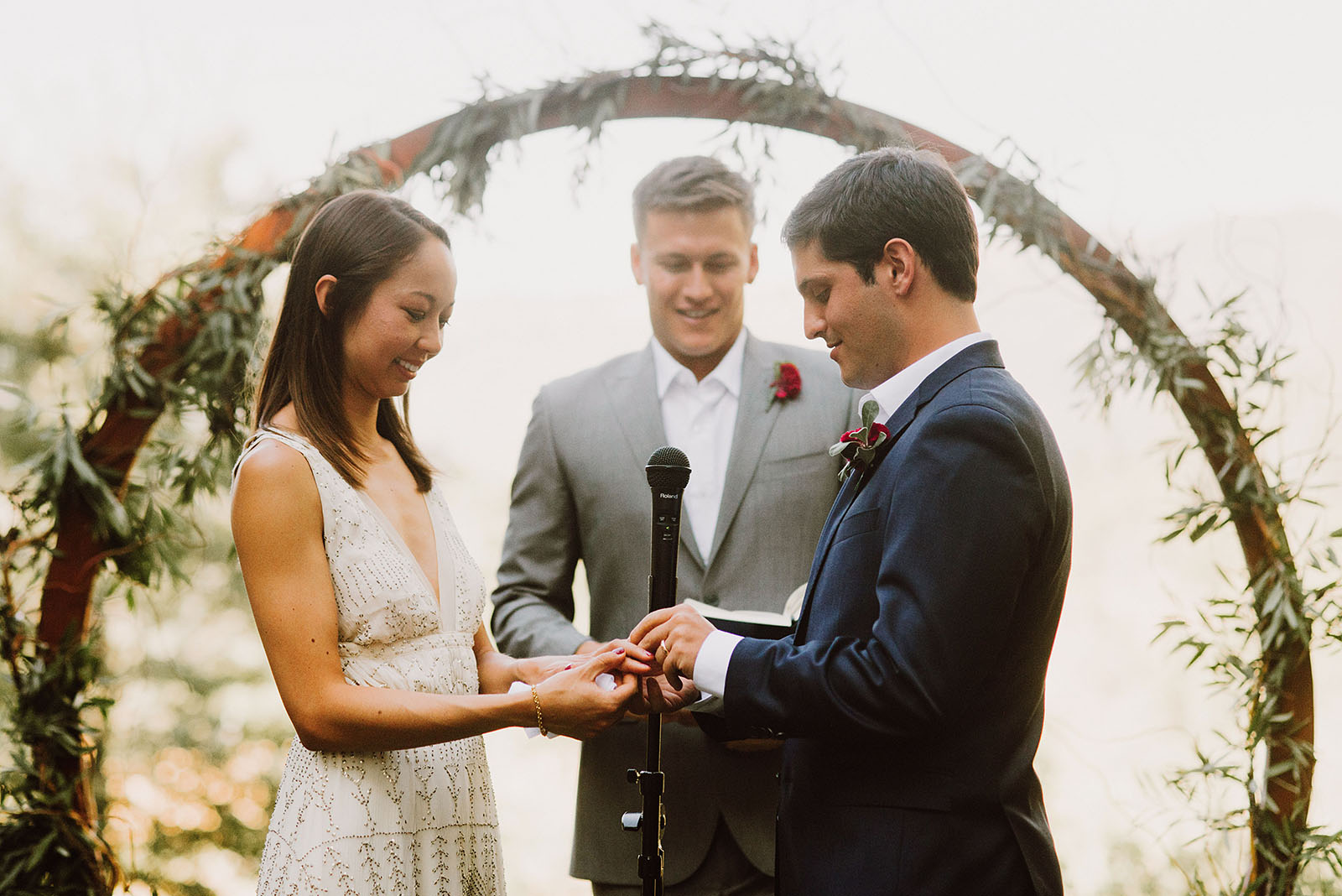 bride and groom exchanging rings at Sacred Mountain Retreat - Portland Wedding photography