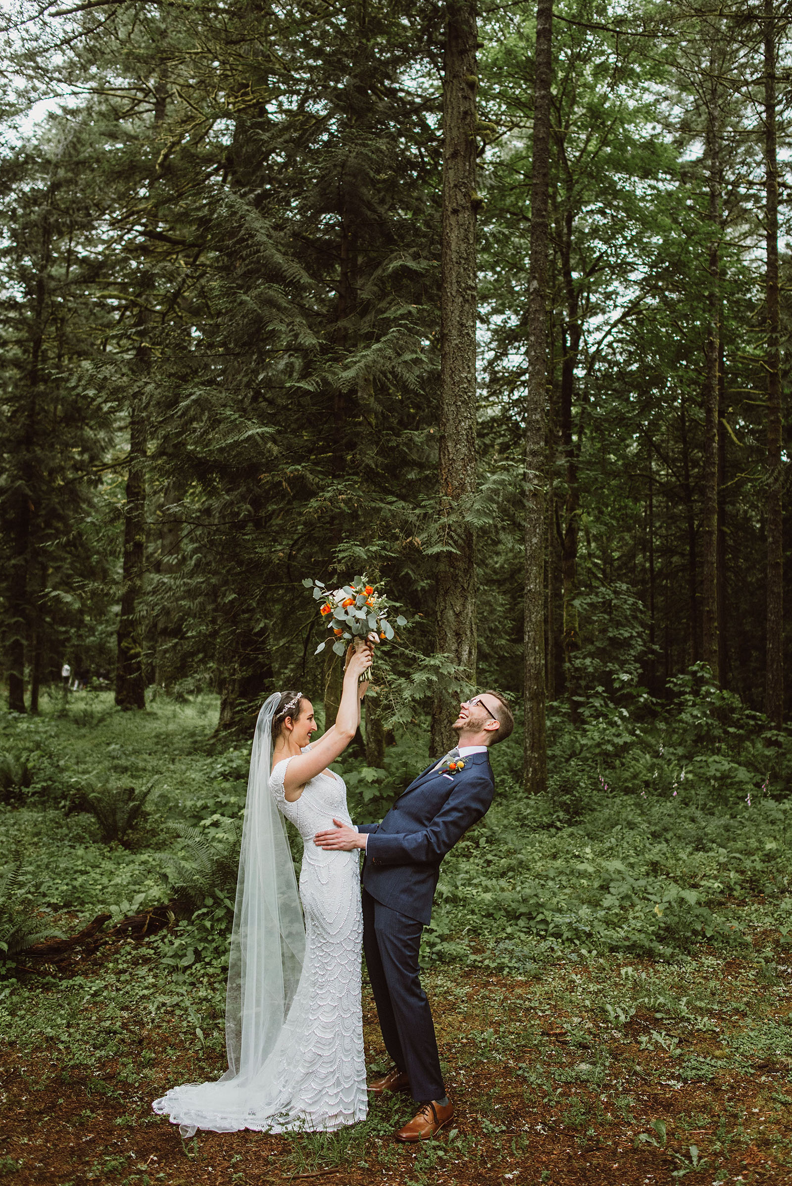 bride and groom laughing in the forest at Camp Angelos - Portland Wedding photography