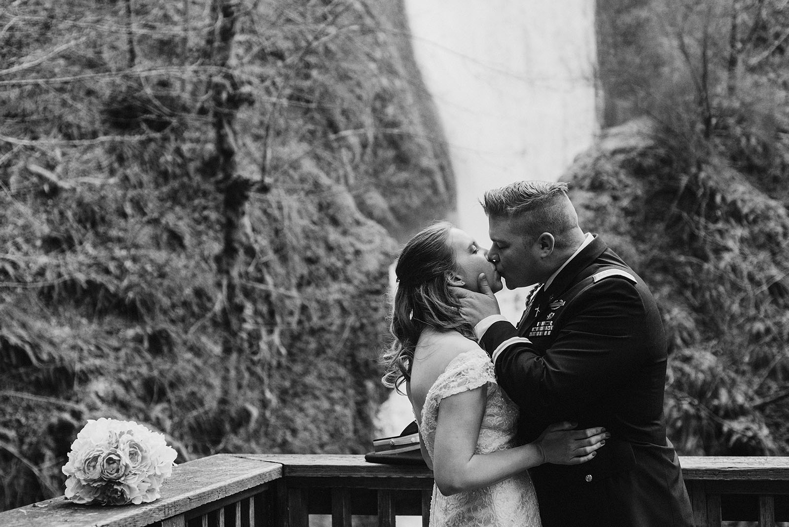bride and groom's first kiss at bridal veil falls - Portland Wedding photography