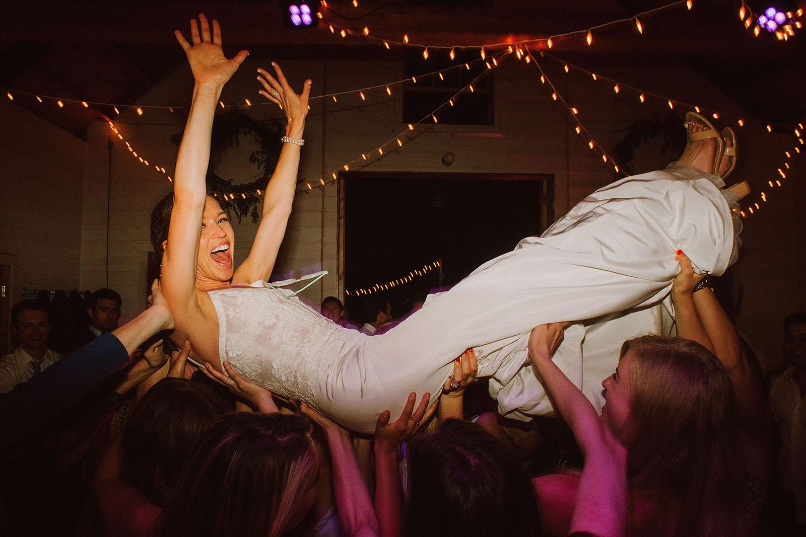 crowdsurfing bride at the Croft Farm on Sauvie Island - Portland Wedding photography