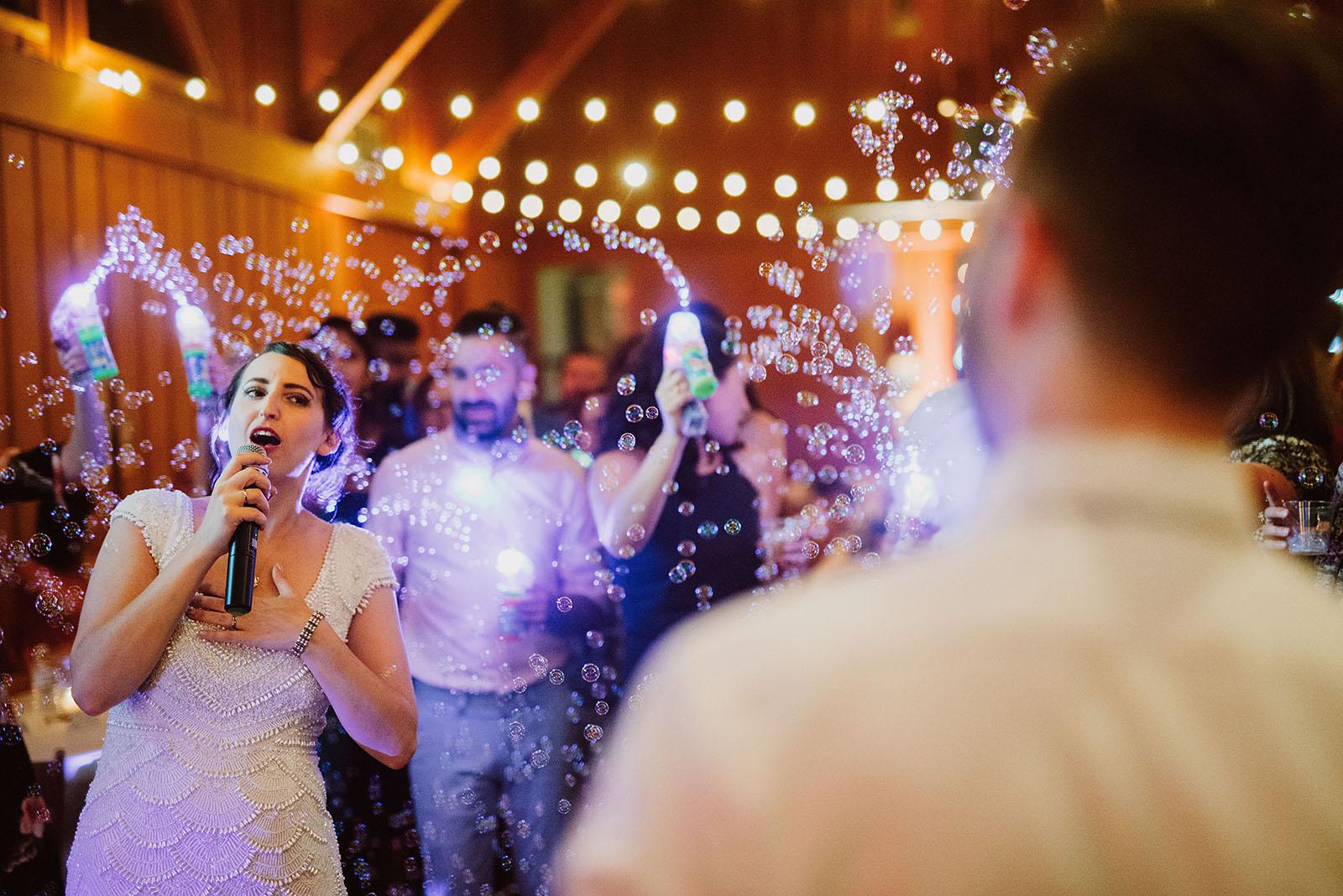 bride doing karaoke at Camp Angelos - Portland Wedding photography