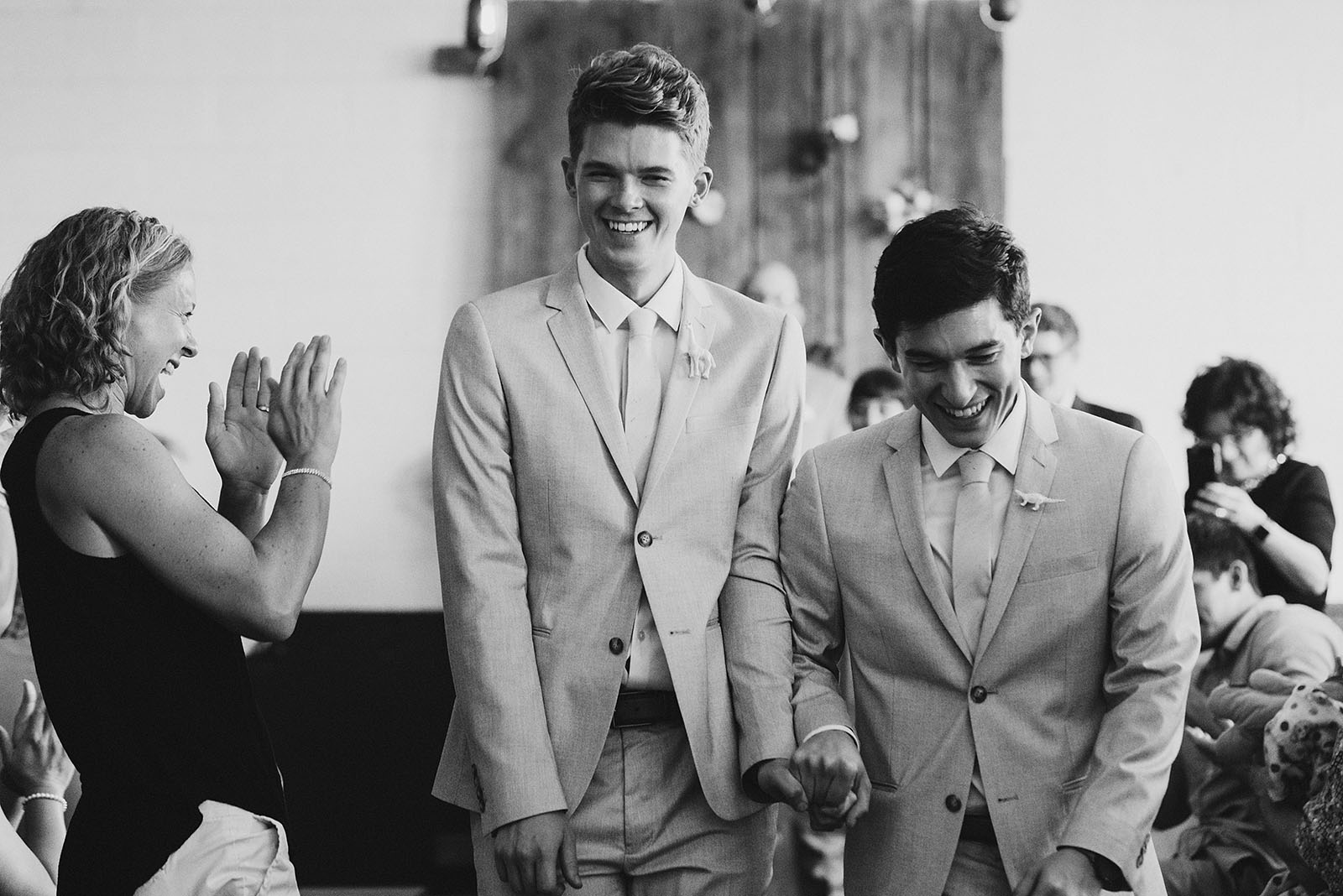 Grooms walking down the aisle together after their Union Pine wedding ceremony