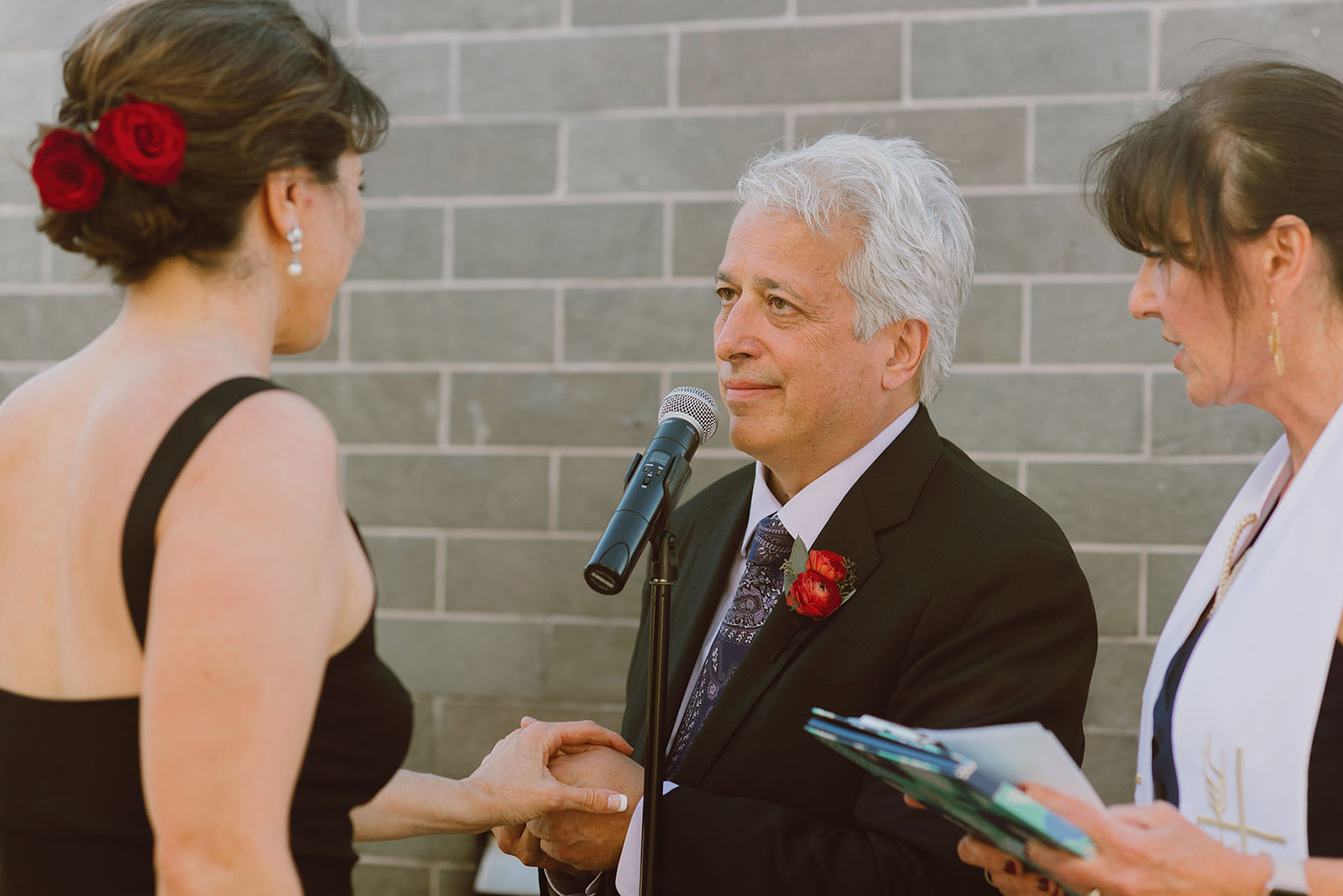 Groom exchanging vows at his Ecotrust Wedding