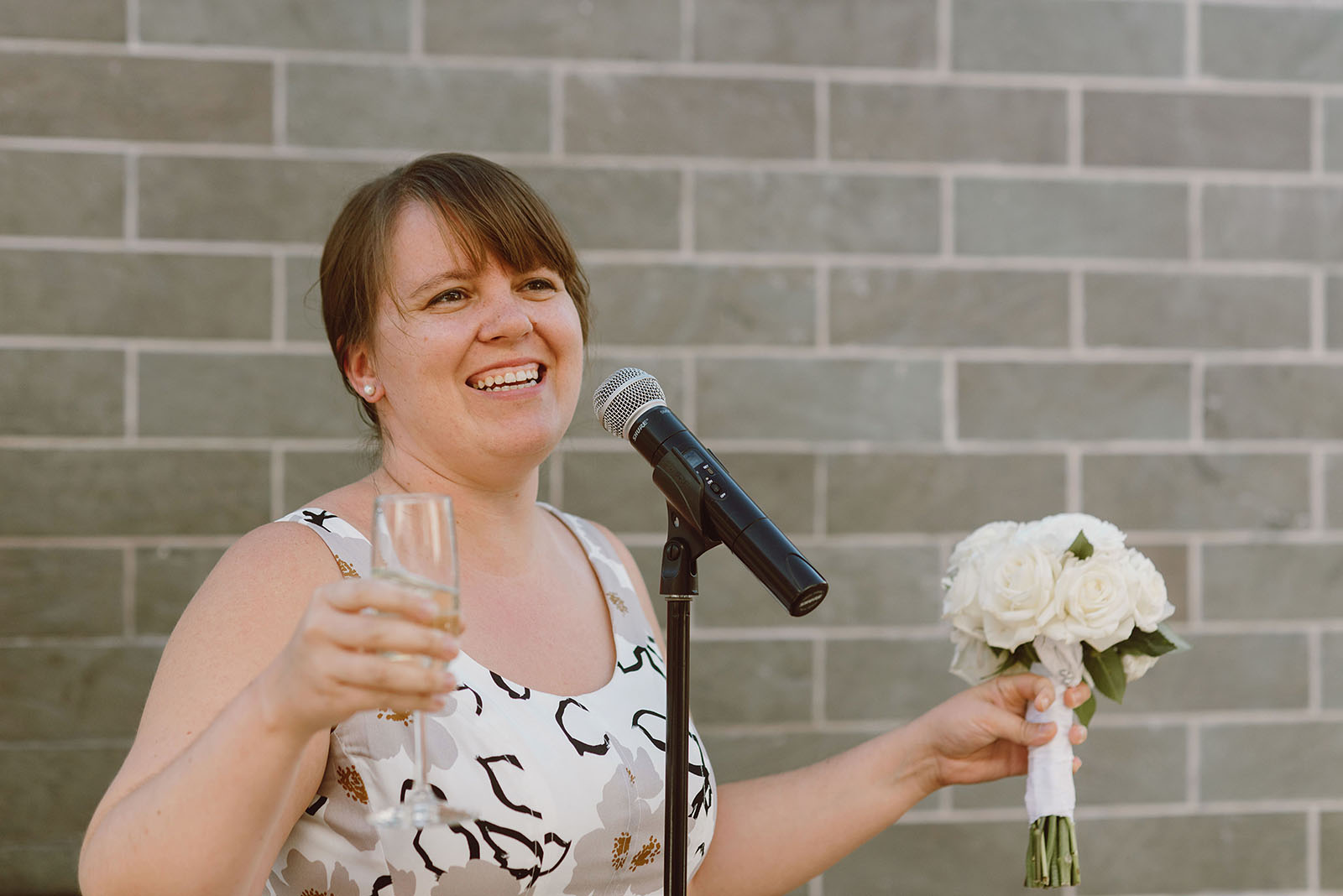 Bride's daughter giving a toast at their Ecotrust Wedding reception